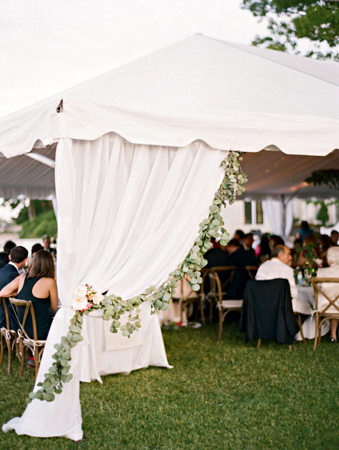 rainy wedding reception tent with greenery