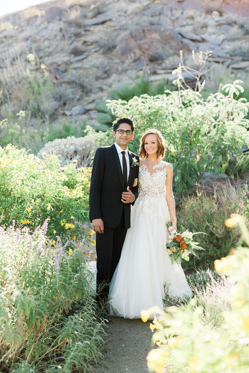 emily adhir wedding couple arm in arm