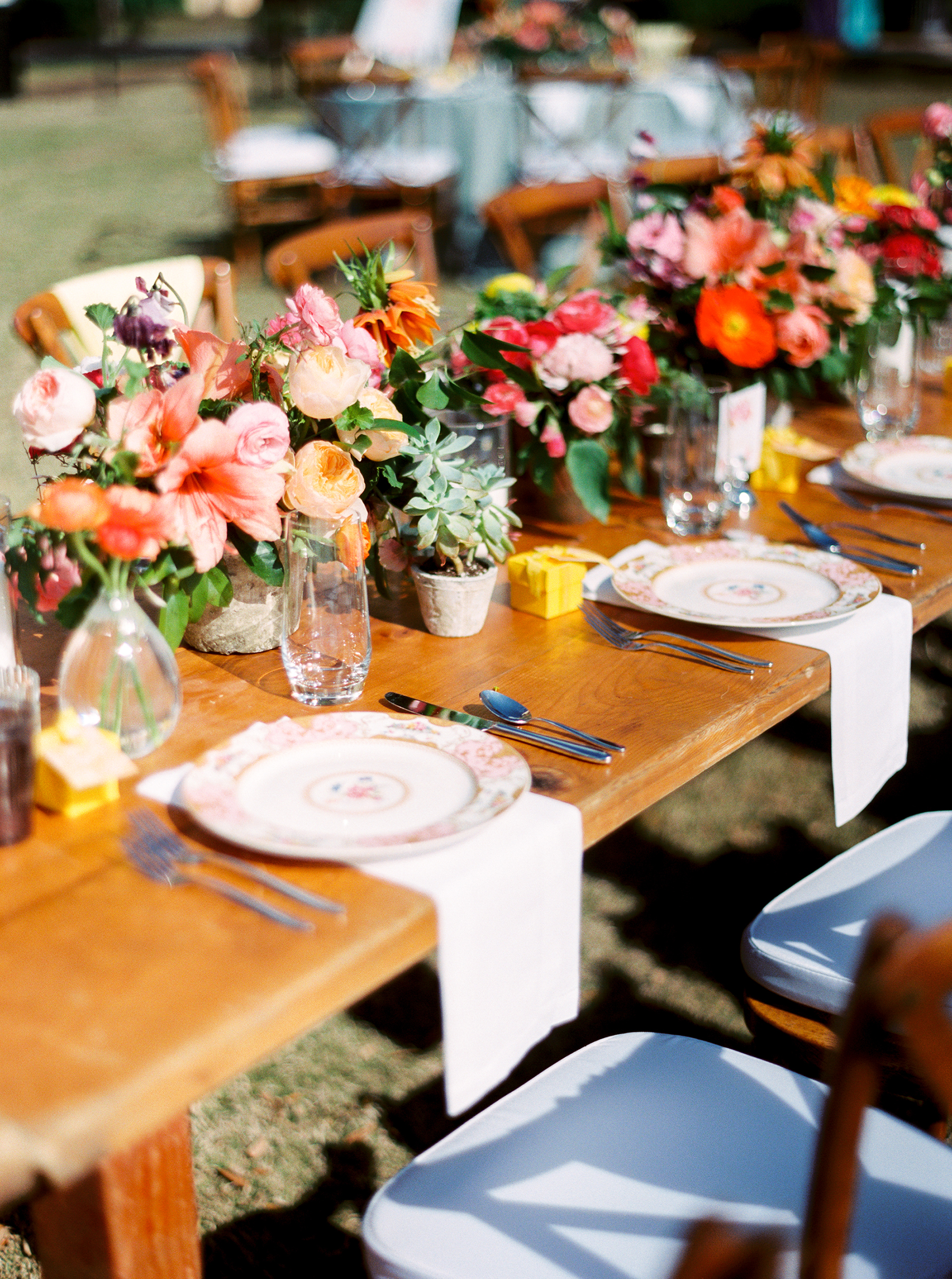 COlorful Cluster Centerpieces on Wooden Table