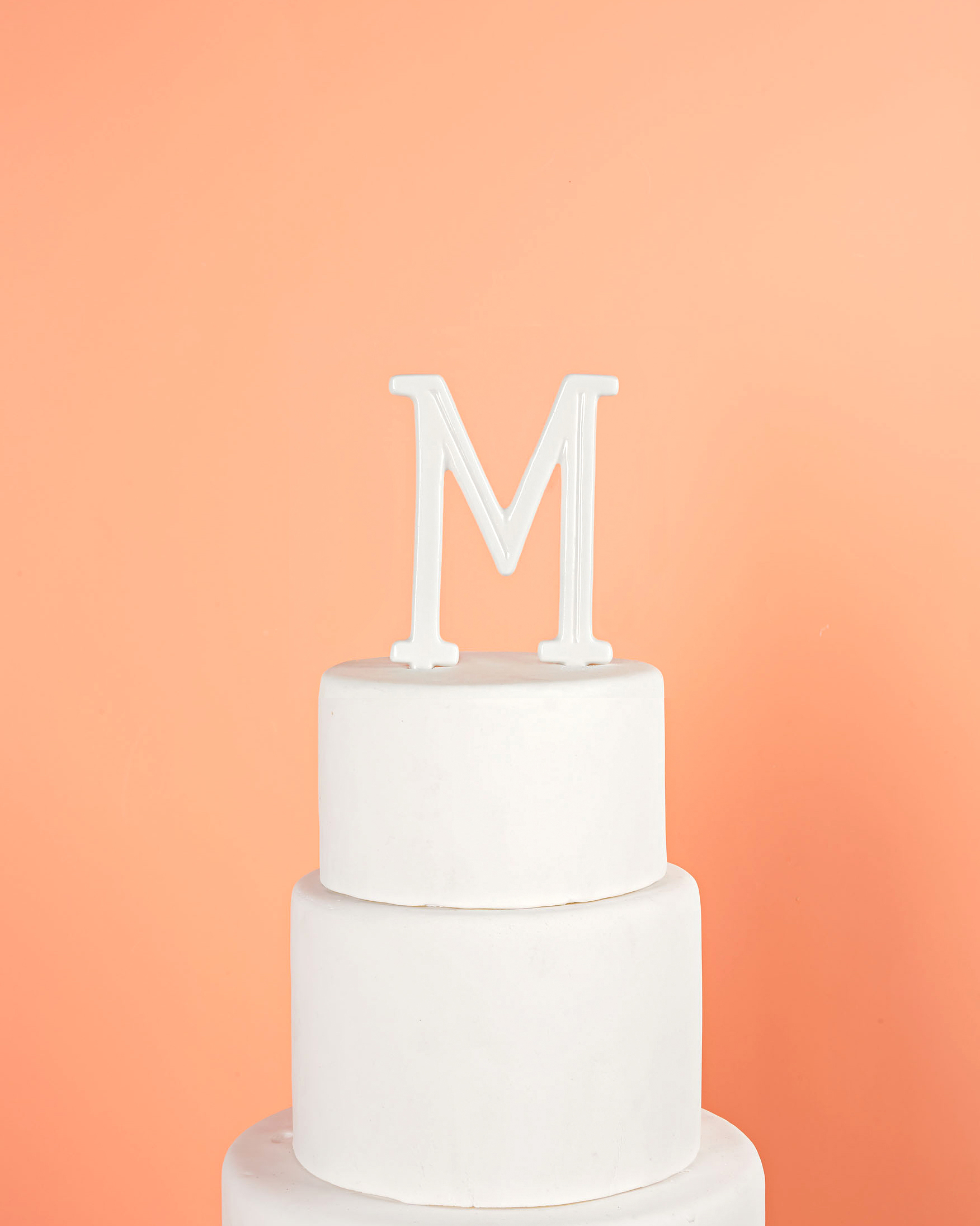 white porcelain monogram cake topper
