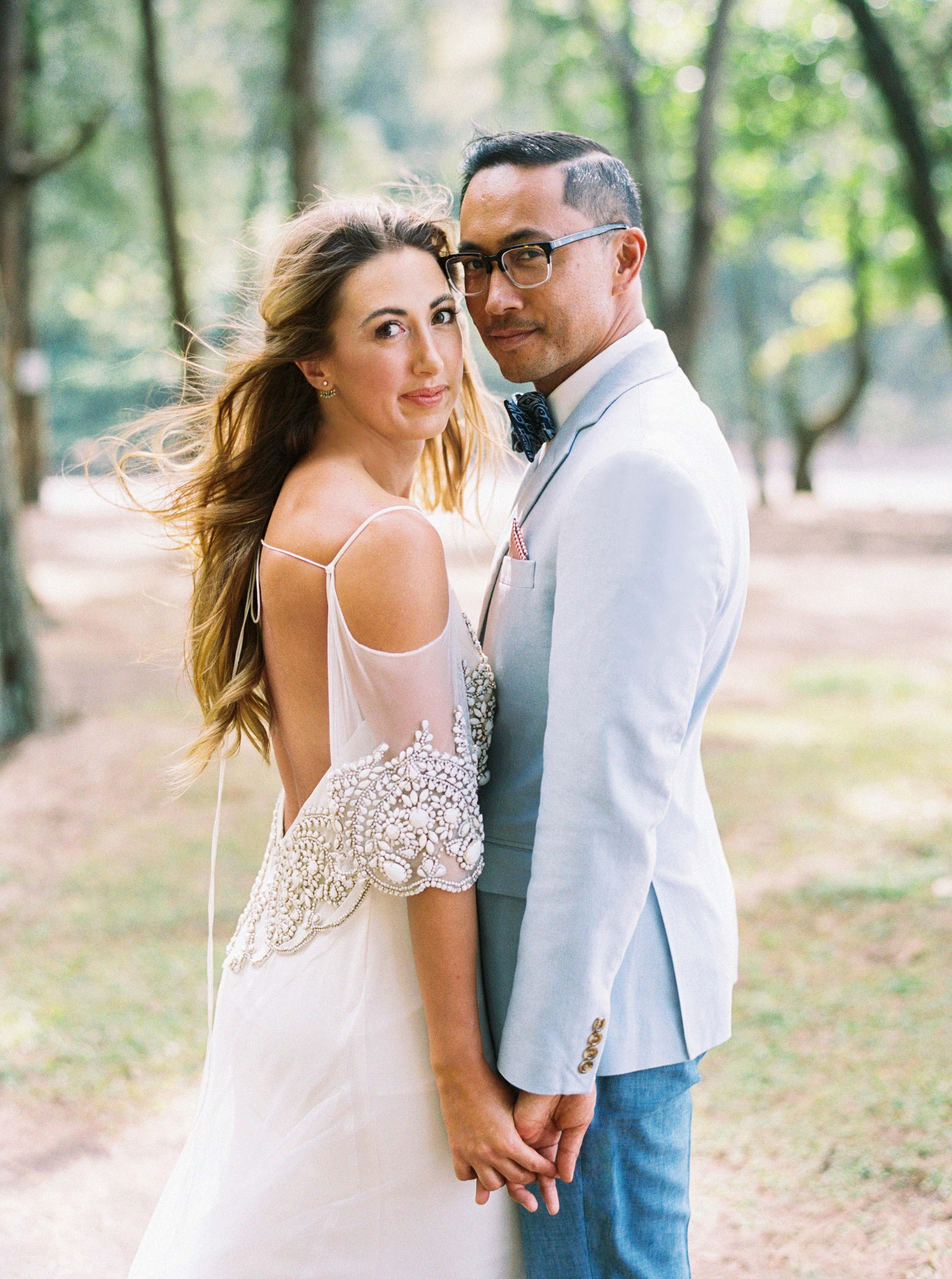 rebecca eryck wedding hawaii couple holding hands