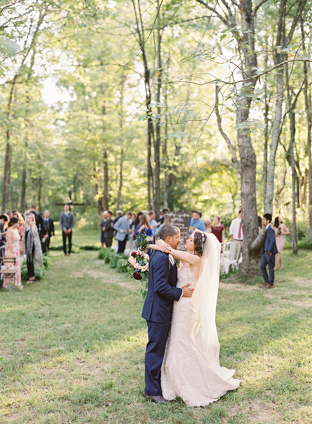 ashley and justin embrace during recessional