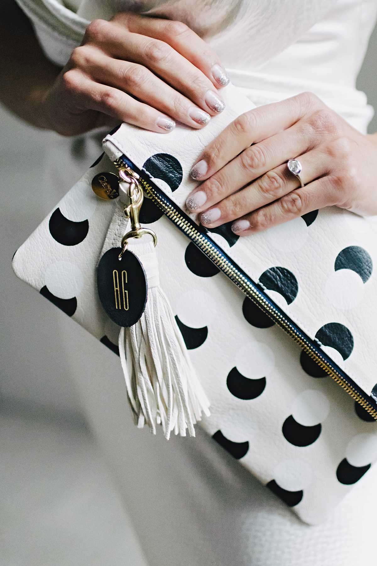 ana and damon black and white clutch