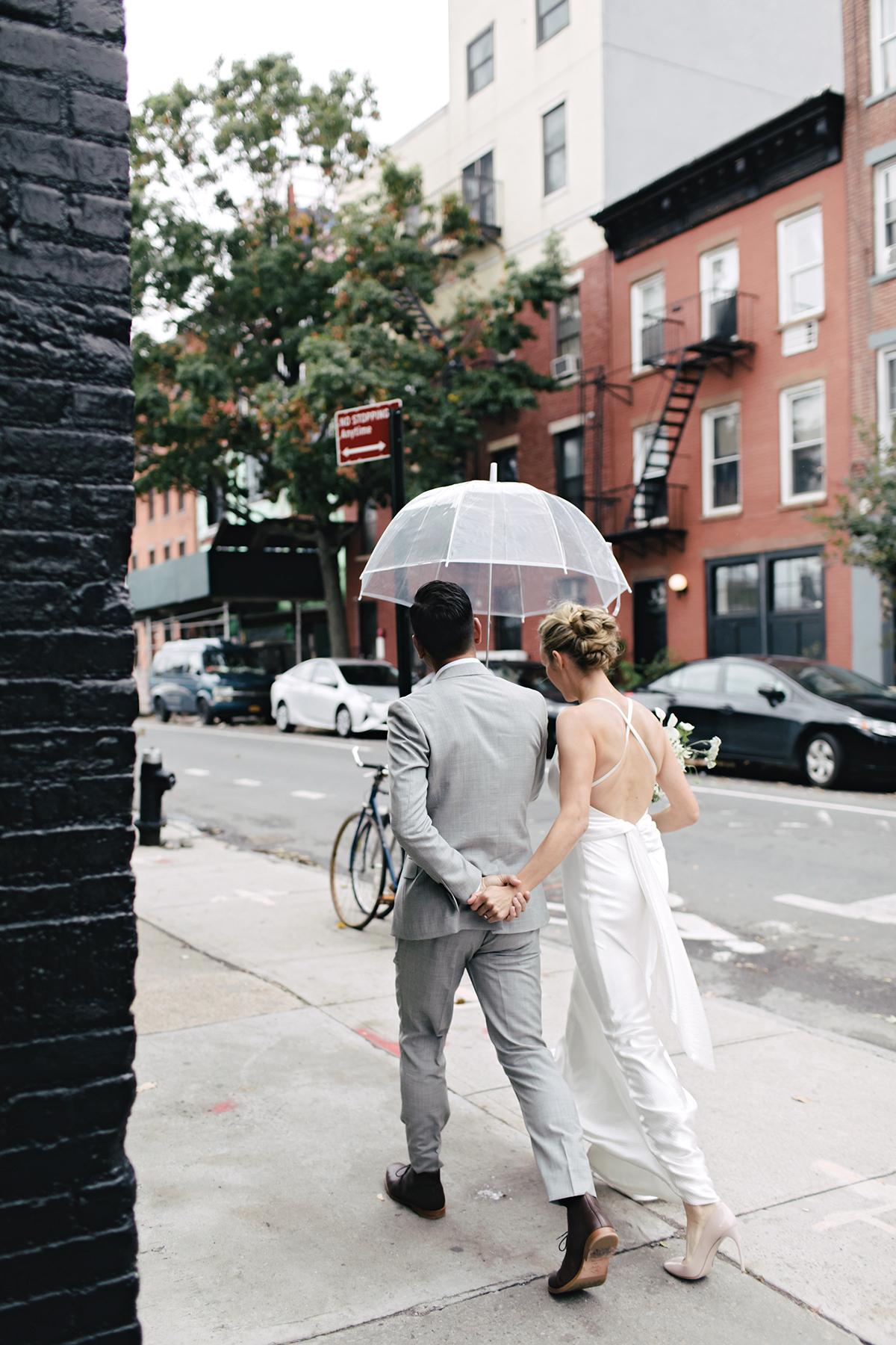 ana and damon walking with umbrella