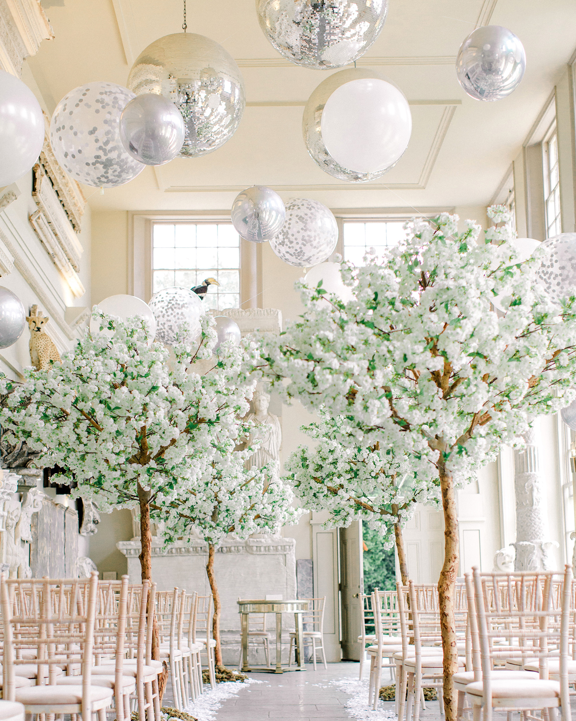 small tree and balloon display high loft ceiling
