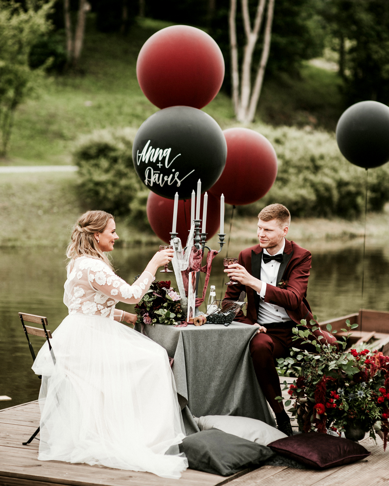 dark red and black wedding balloon decor wedding color scheme