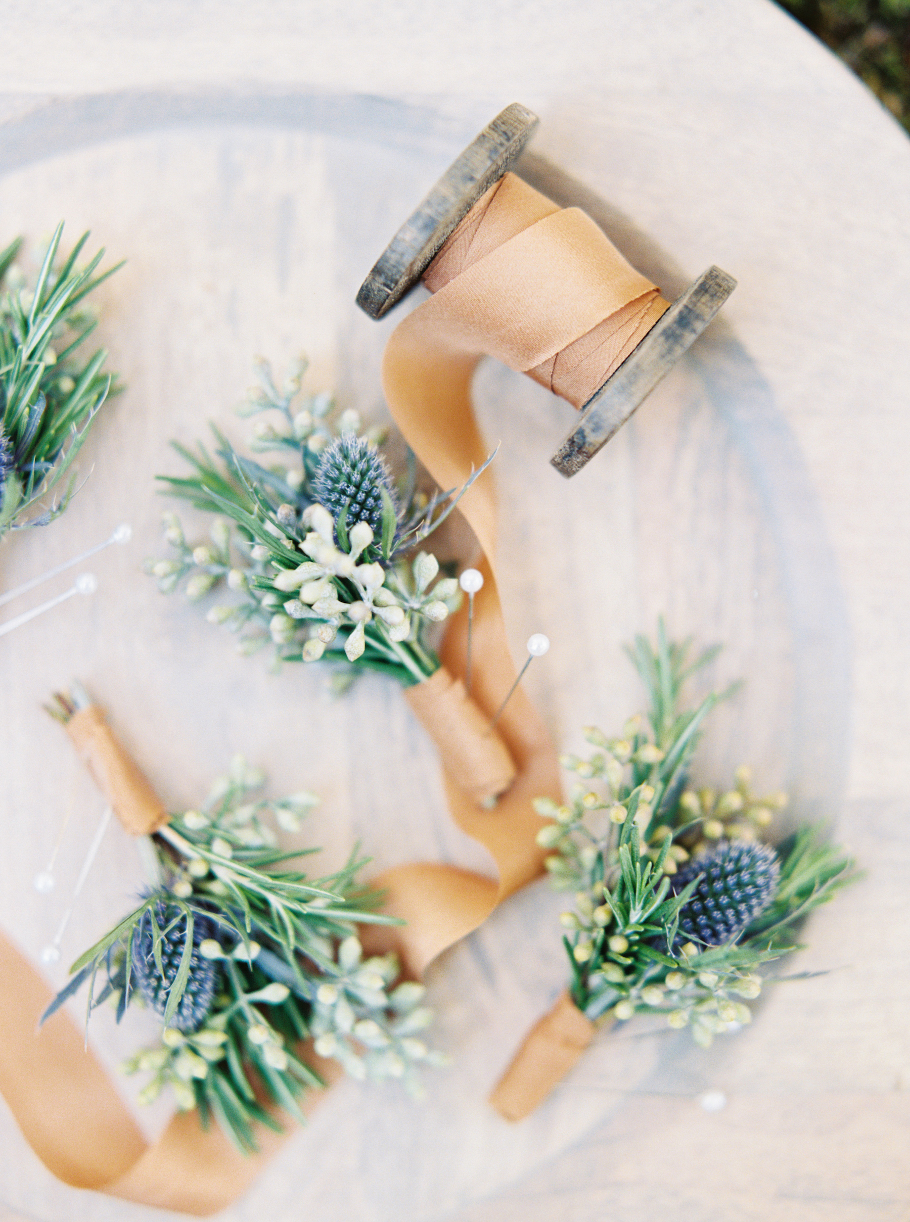 green-and-blue boutonnieres