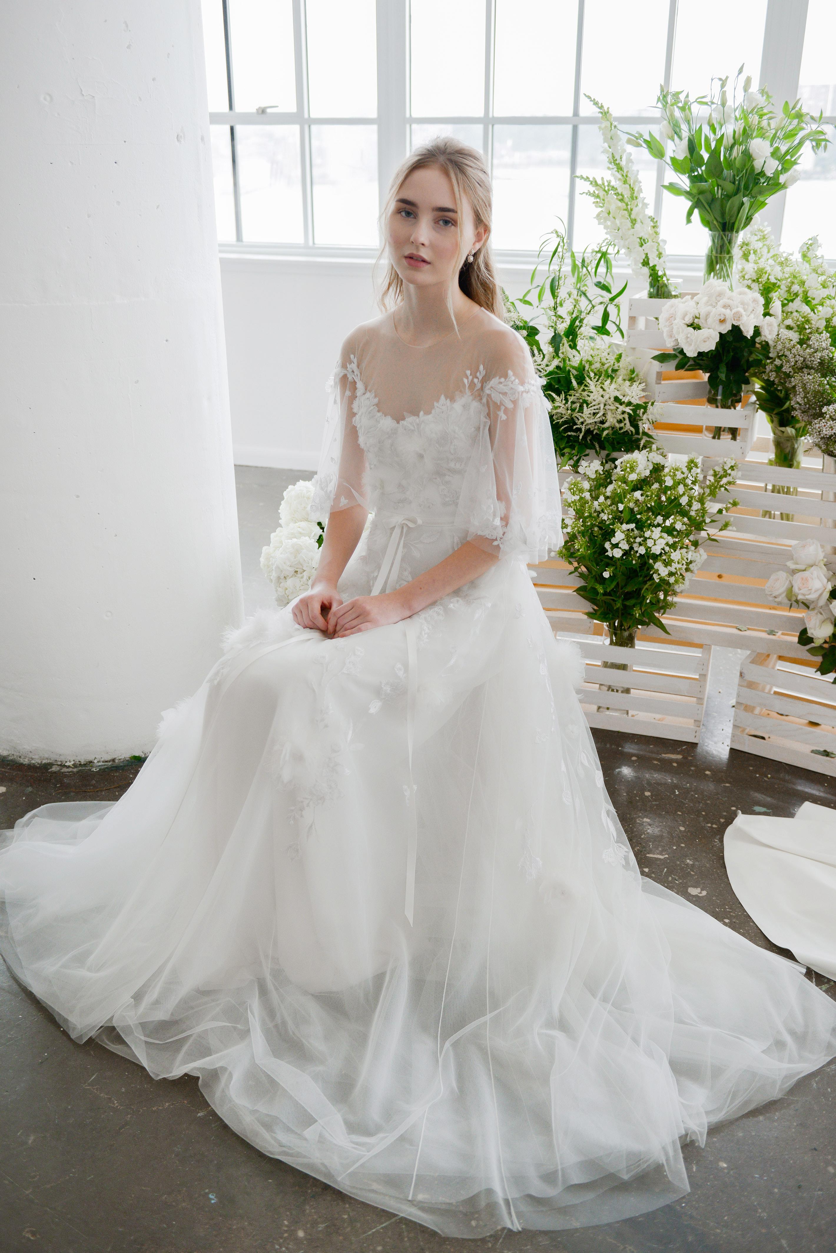 marchesa notte high sheer neckline bridal wedding dress with three-quarter length sleeves fall 2018