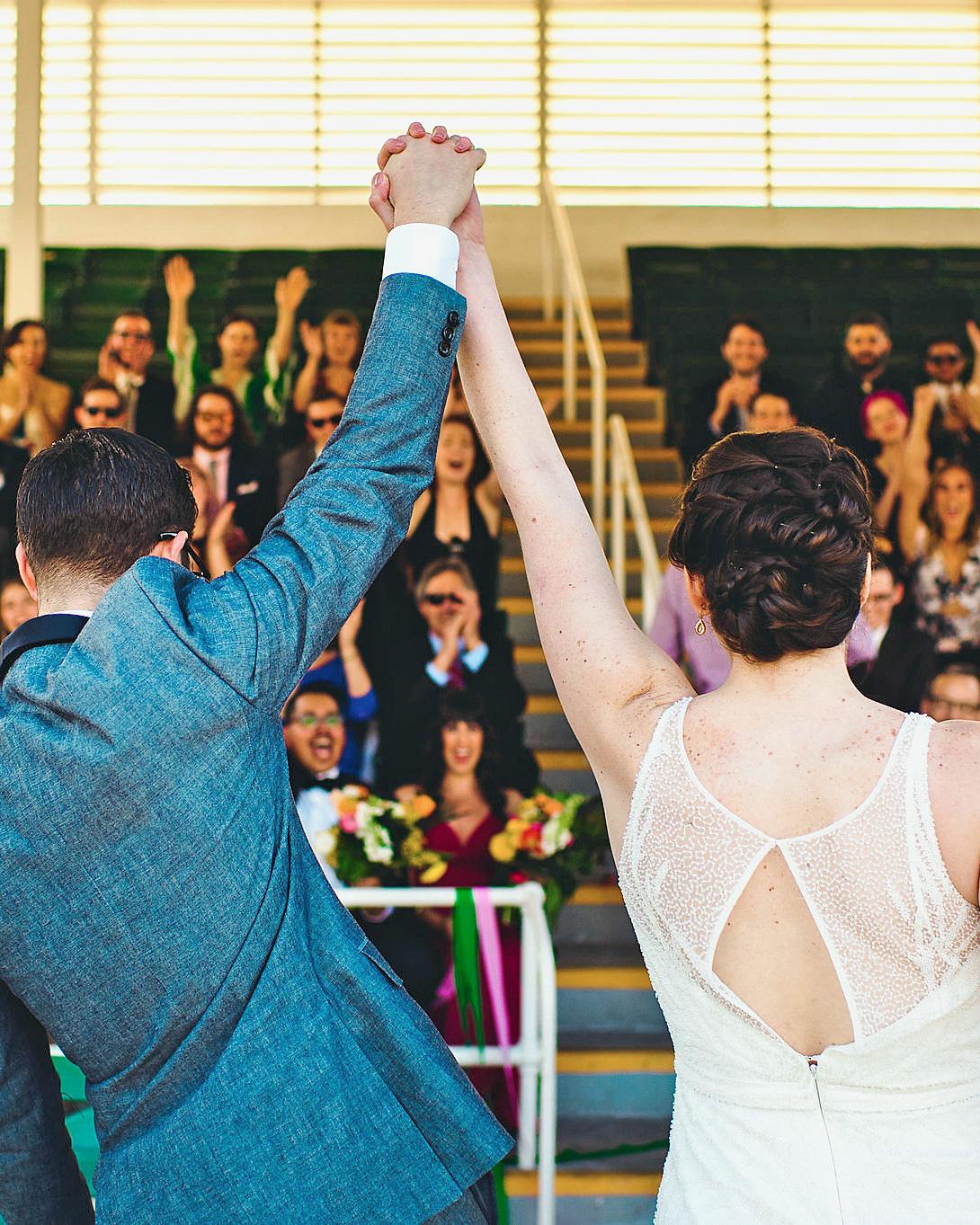 becca zac wedding ceremony hands up