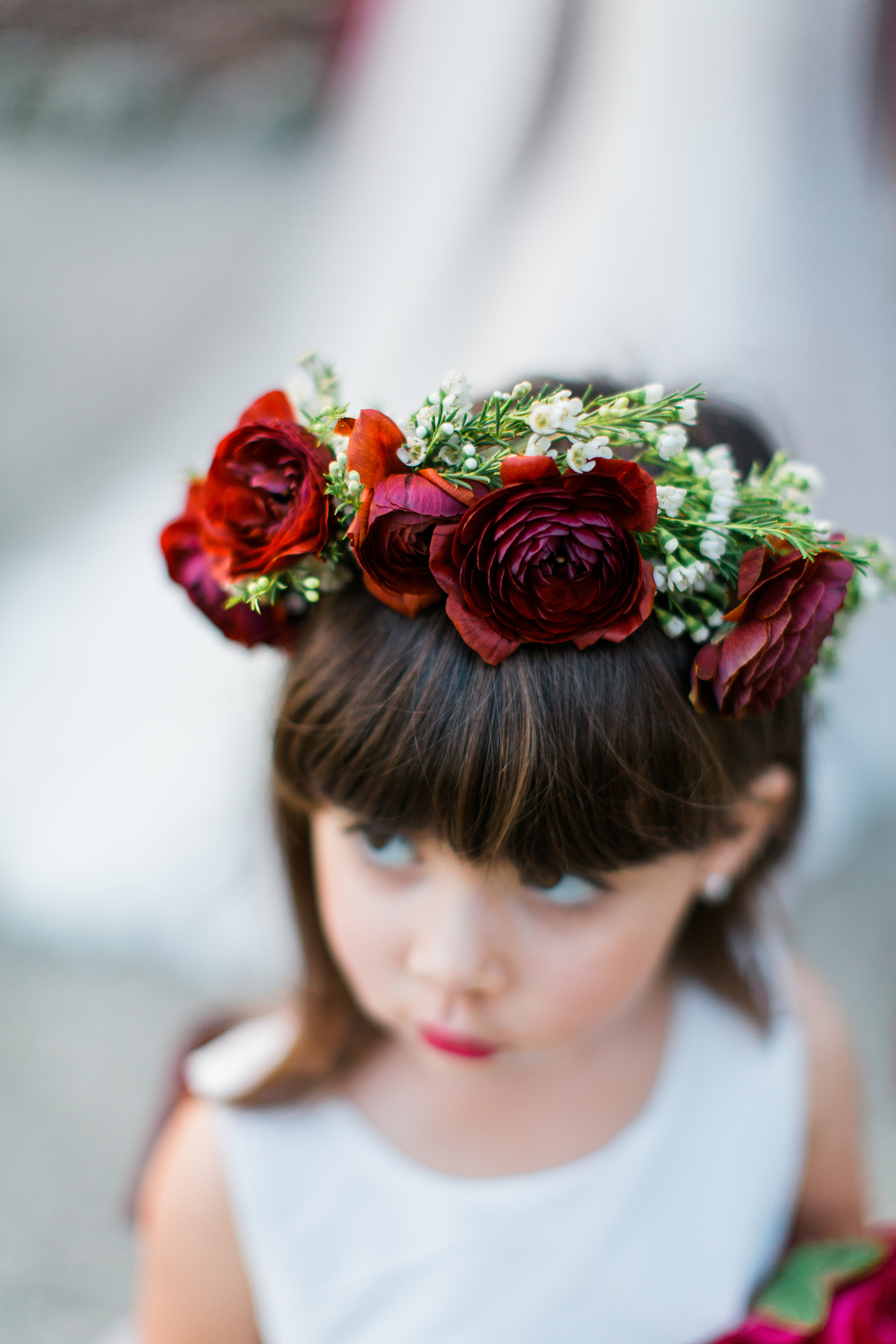 Flower Girl Bun Hairstyle Bangs and Blooms