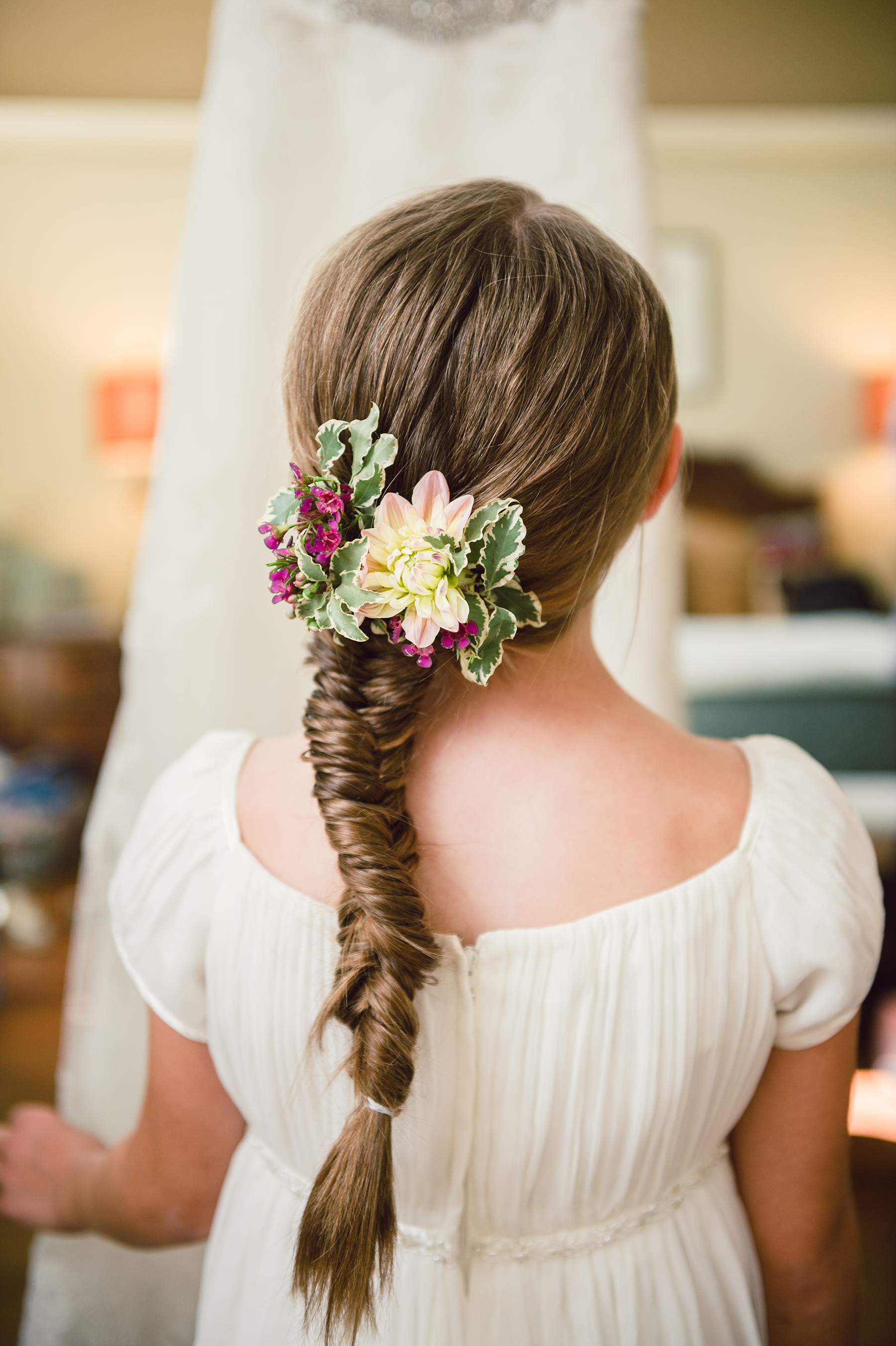 Flower Girl Hairstyle Fishtail Braid with Flower Piece