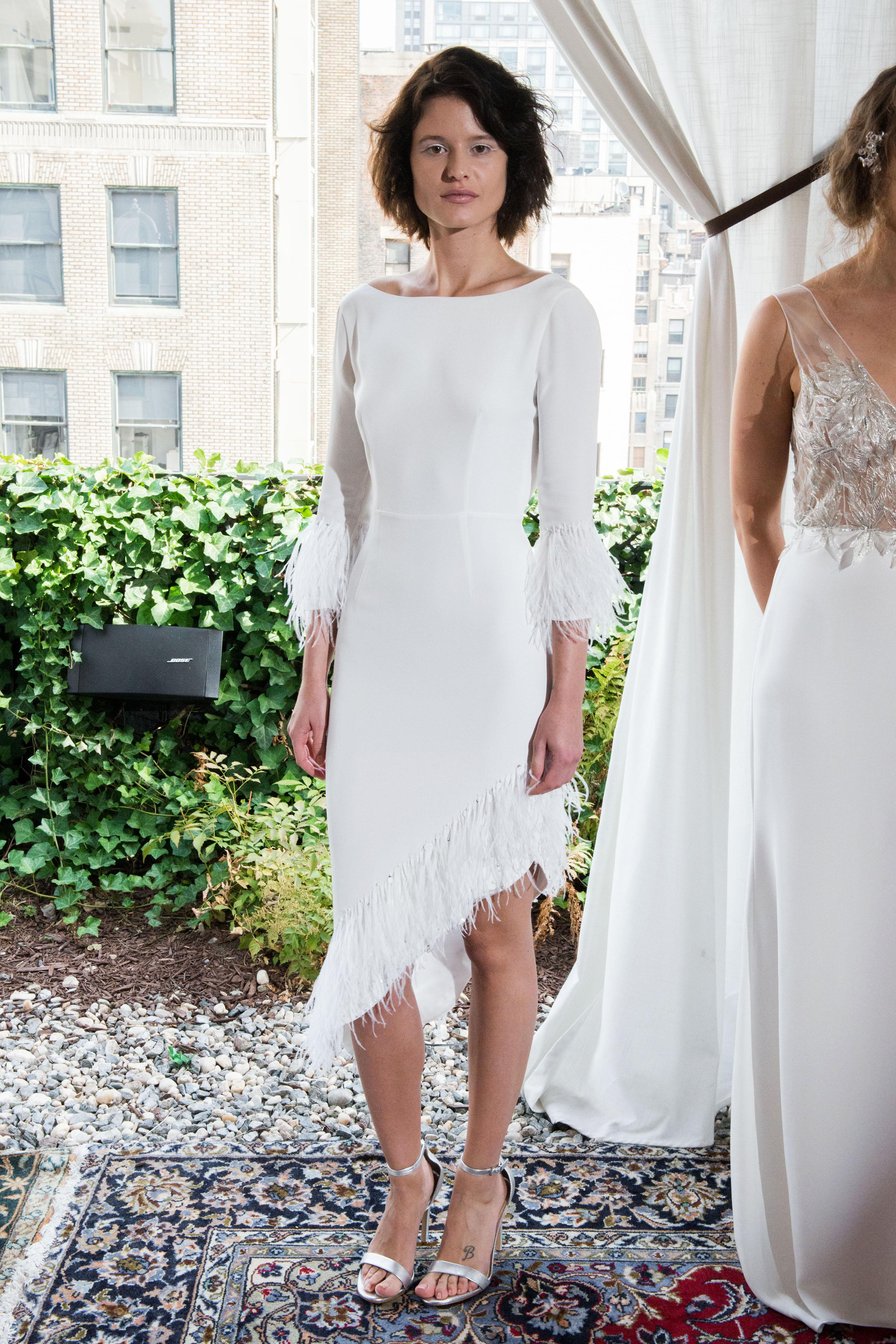 alexandra grecco wedding dress fall 2018 short asymetrical fringe three-quarter length sleeeves