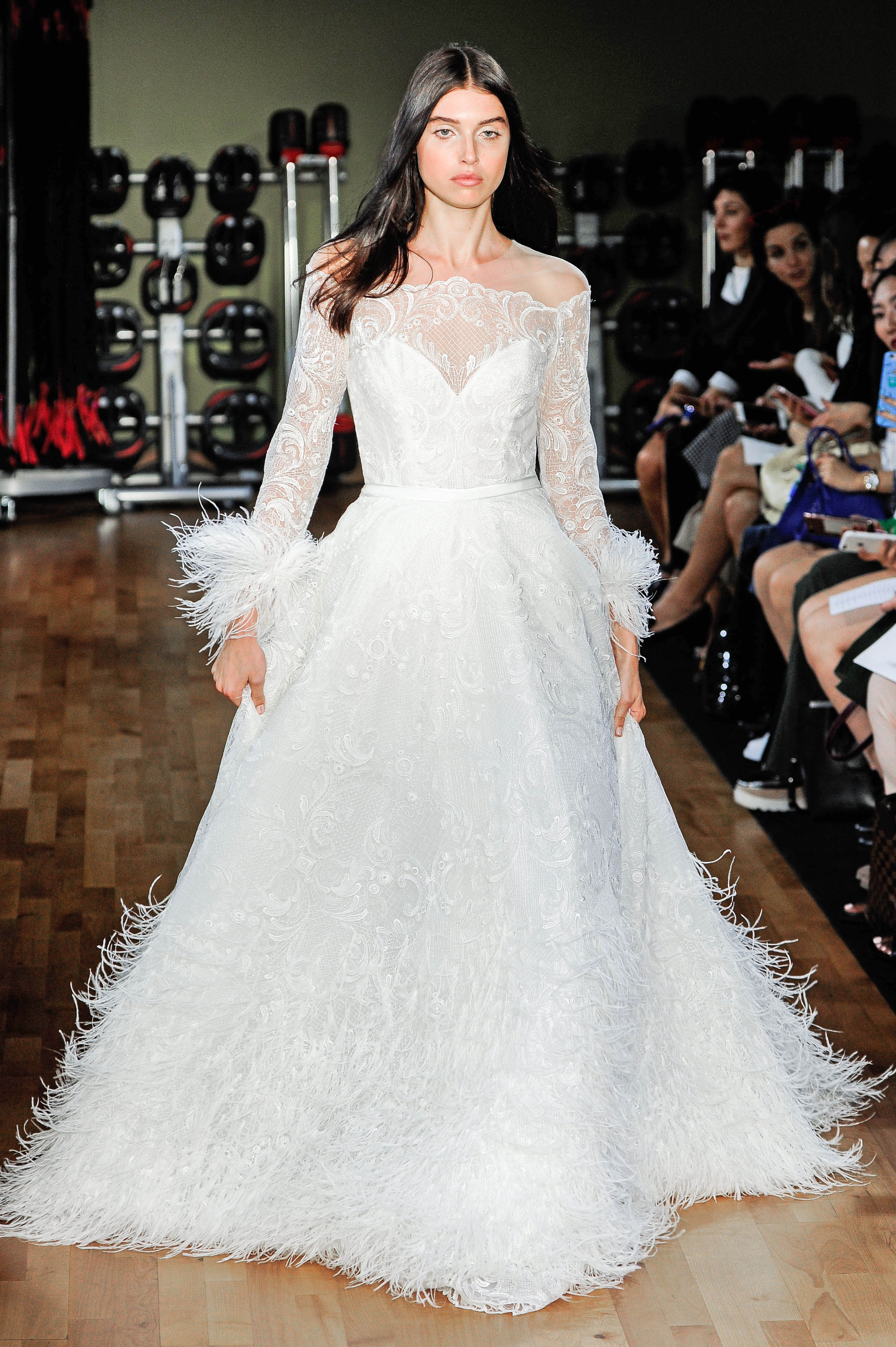 rivini by rita vinieris off-the-shoulder long sleeves wedding dress with feathers fall 2018