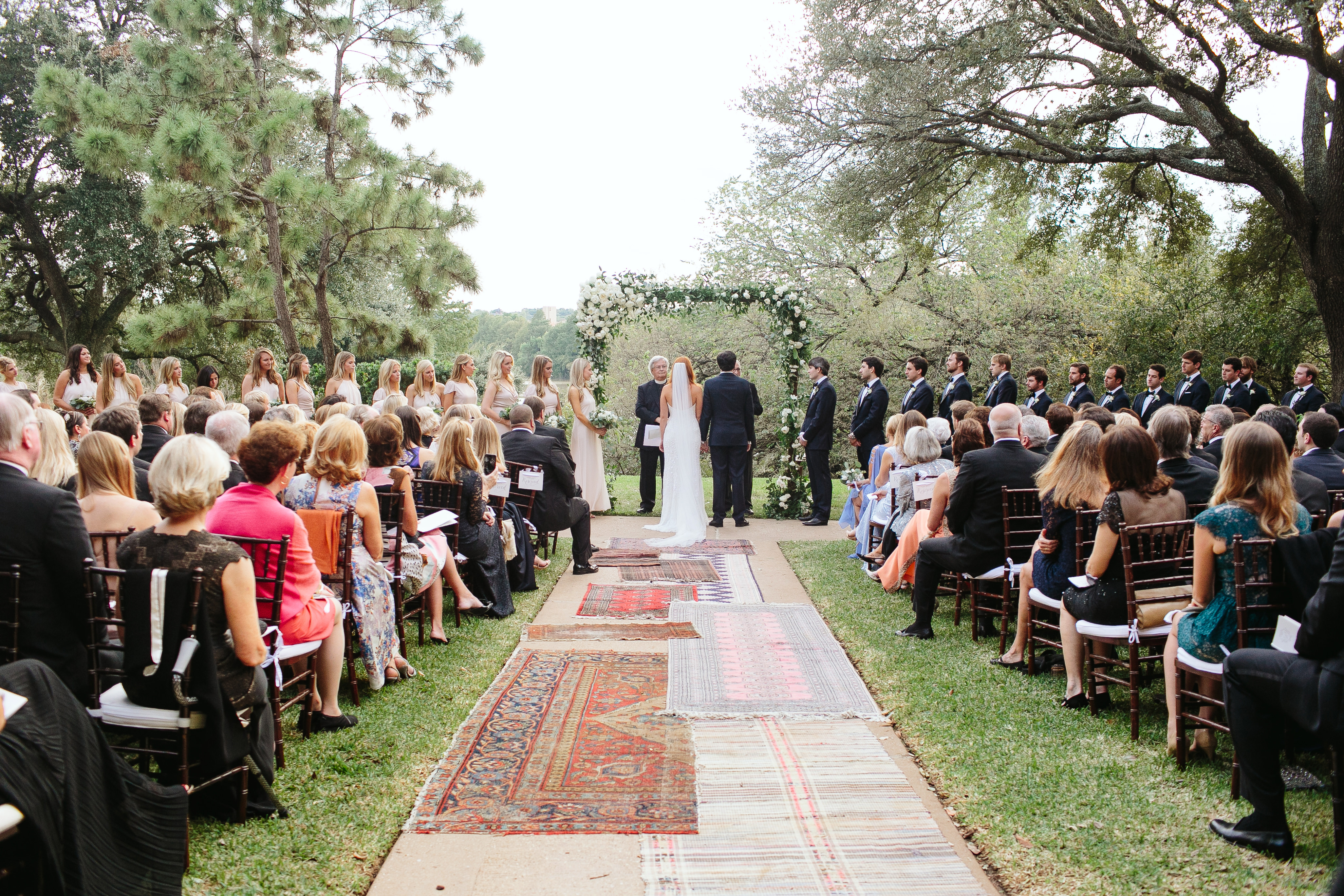 Wedding with rugs on aisle