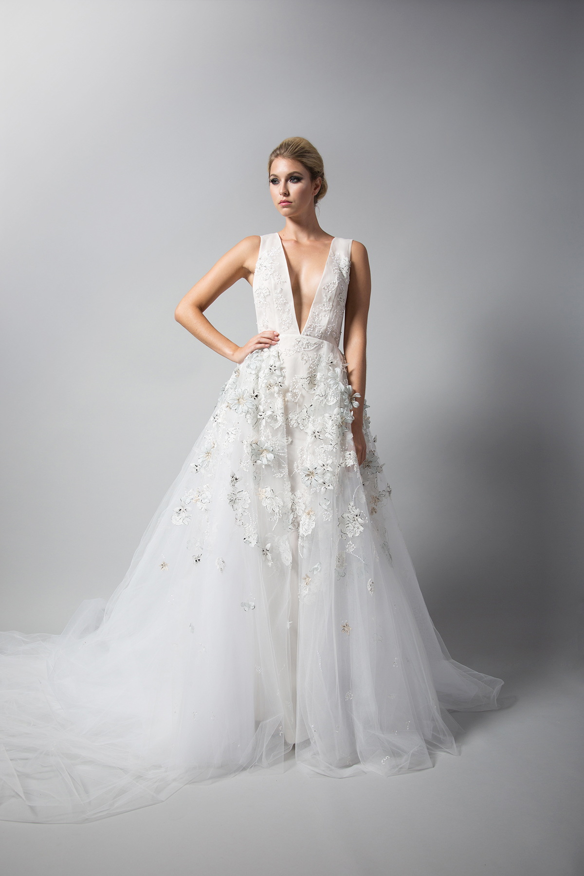 randi rahm tule wedding dress with straps and flower embellishments fall 2018