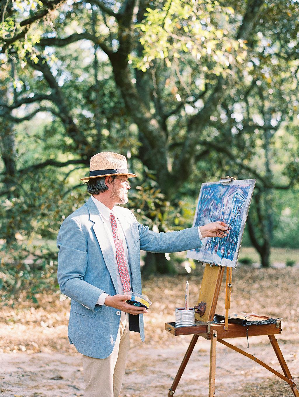 man creating plein air painting