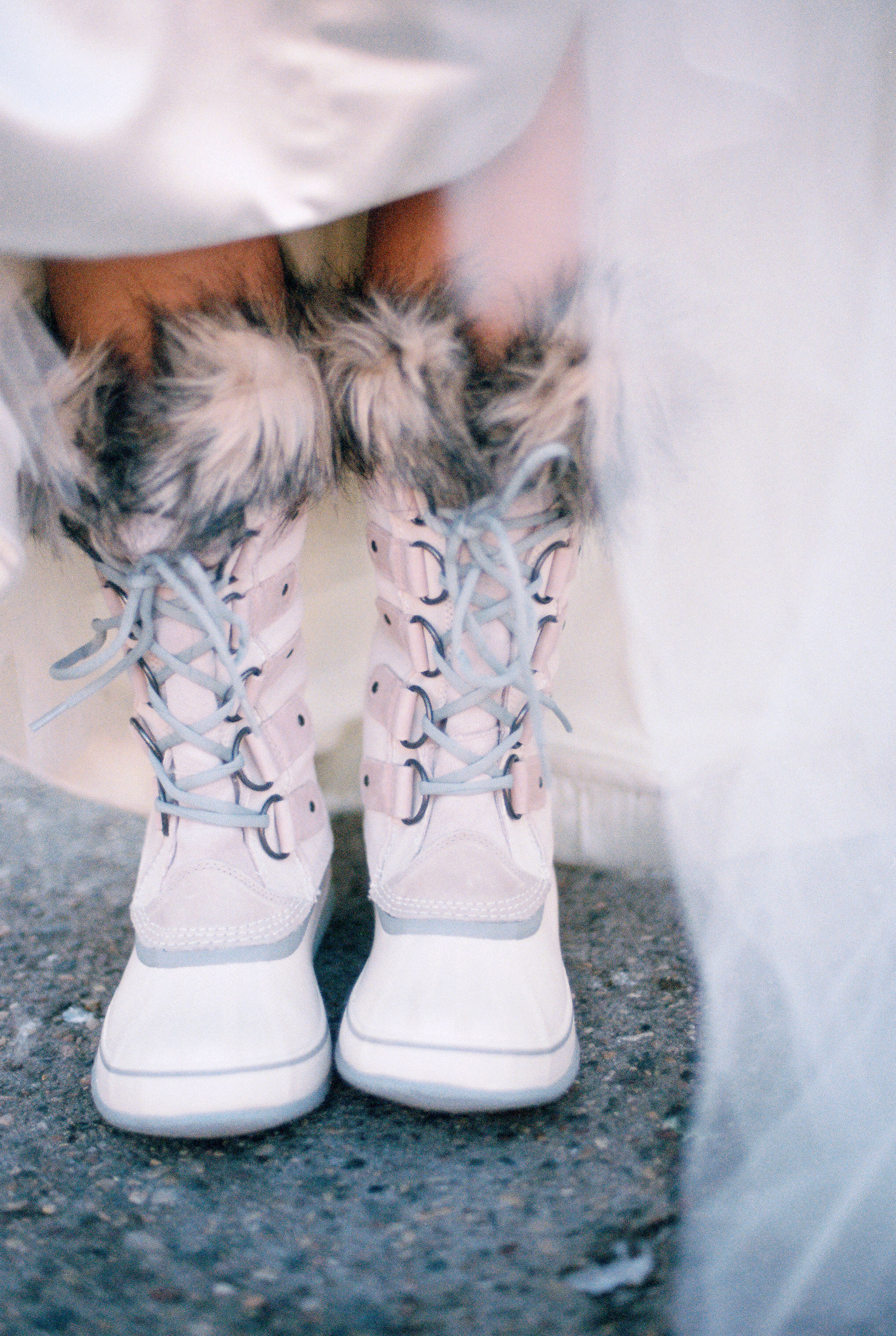 bride wearing winter boots