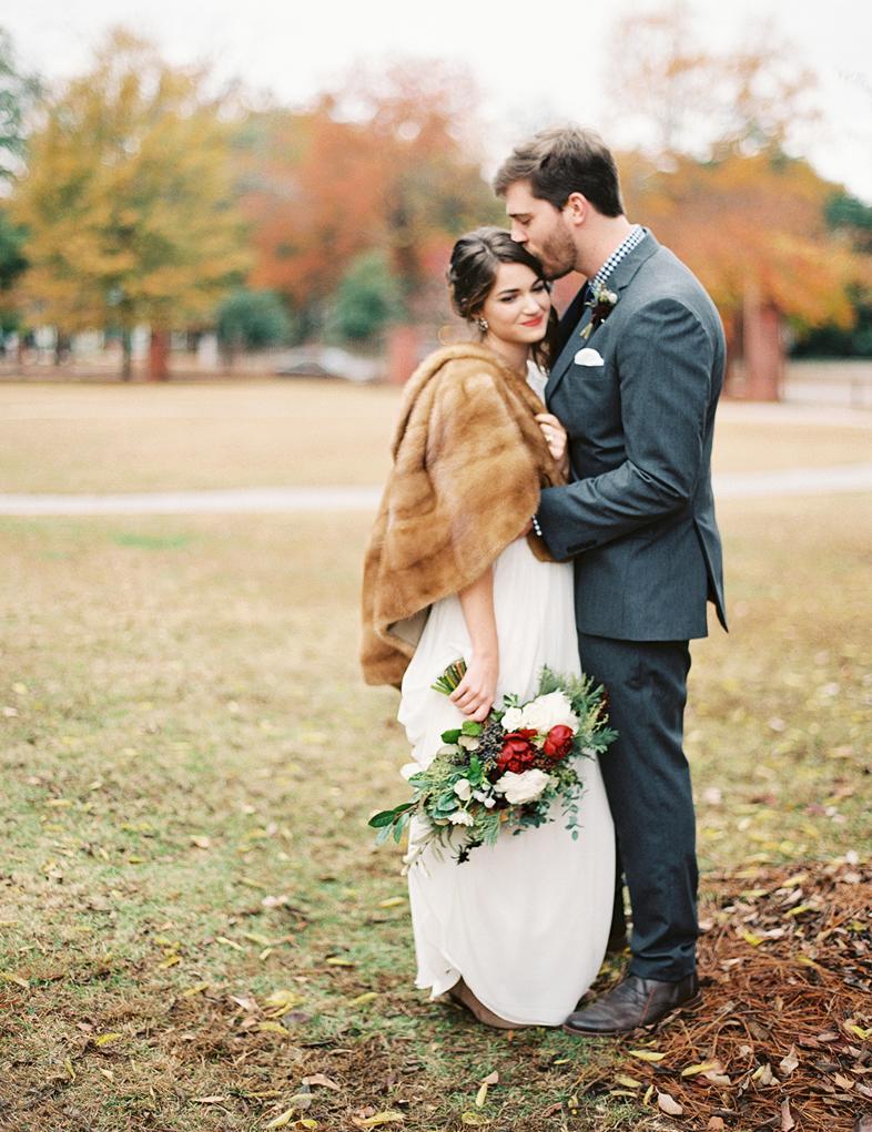 bride wearing fur groom
