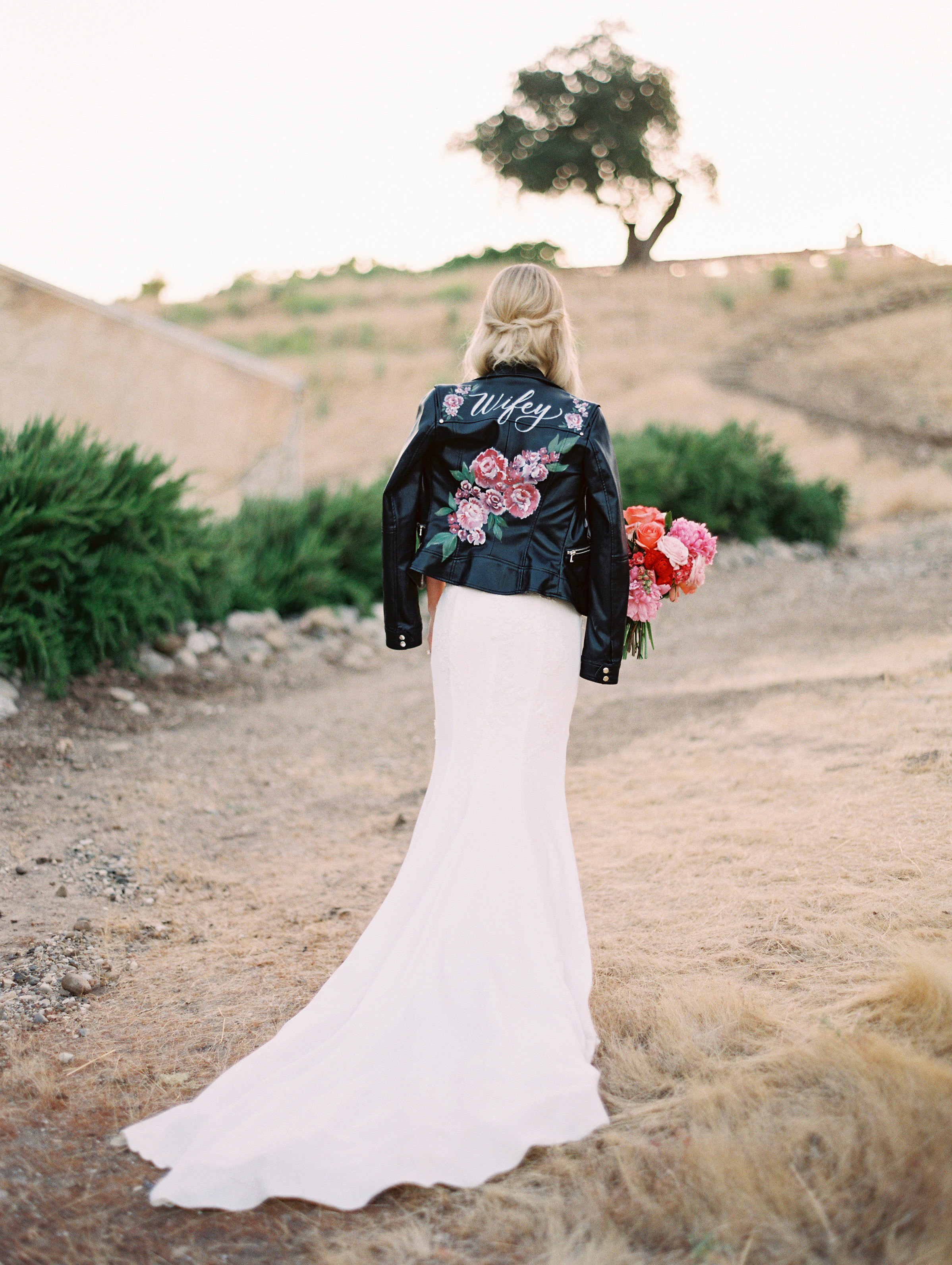 bride wearing leather jacket