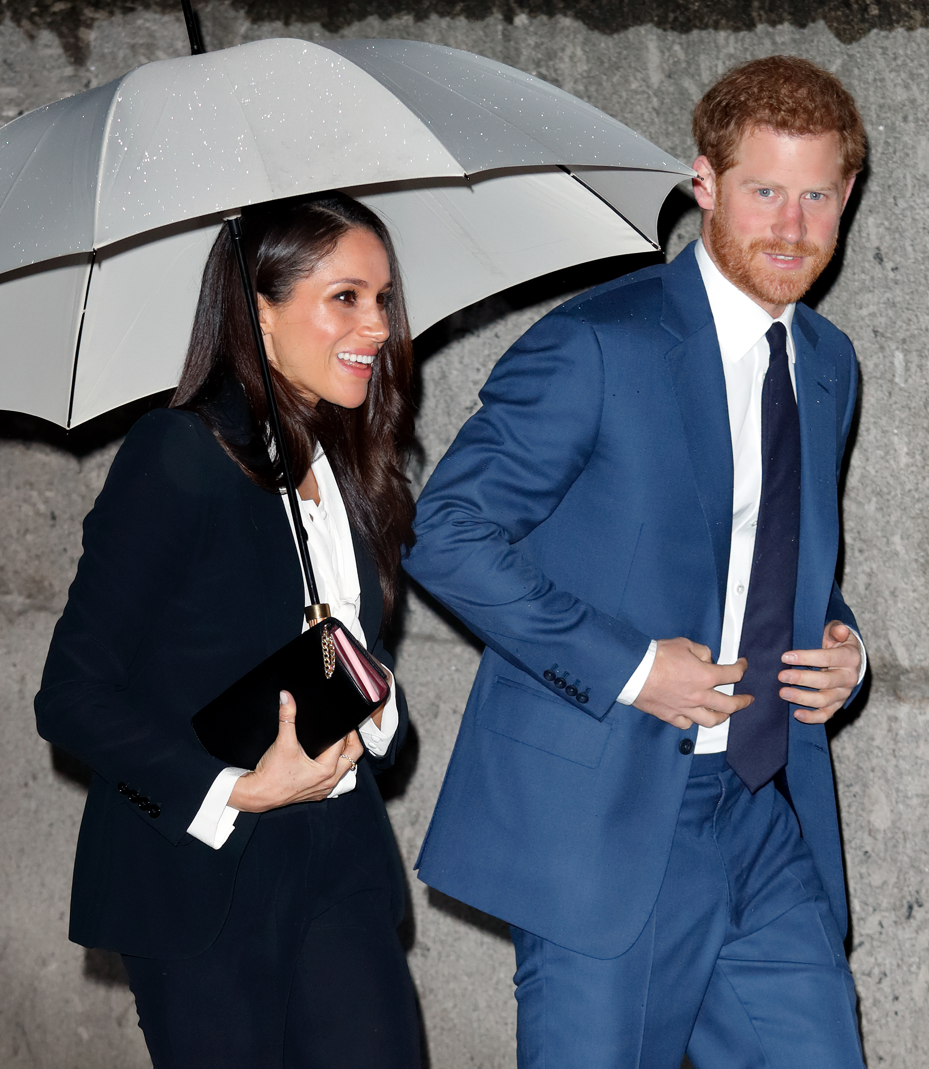 Meghan Markle and Prince Harry with Umbrella