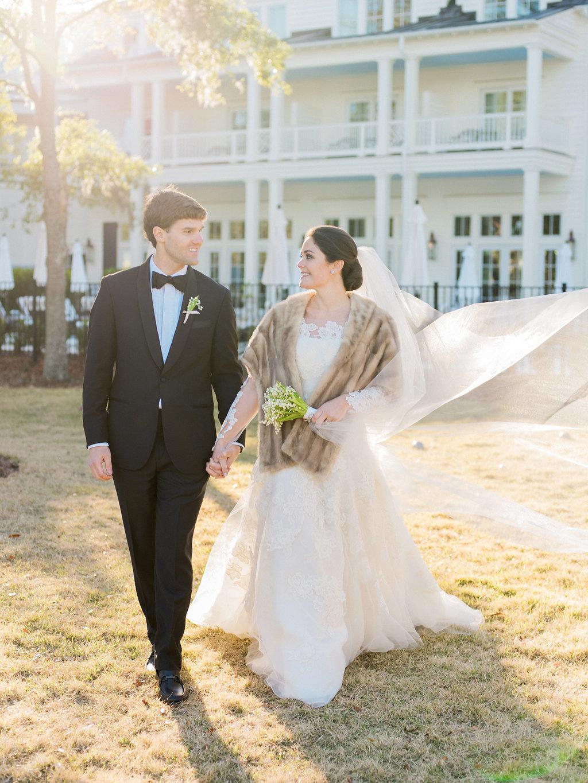 shelby barrett wedding couple holding hands
