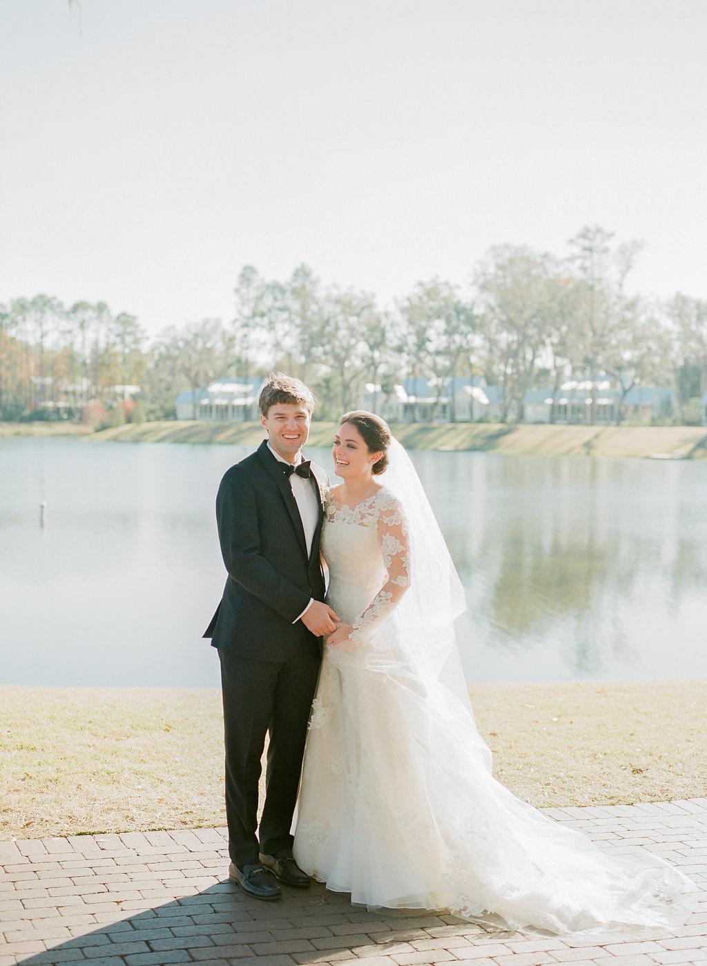 shelby barrett wedding couple by lake