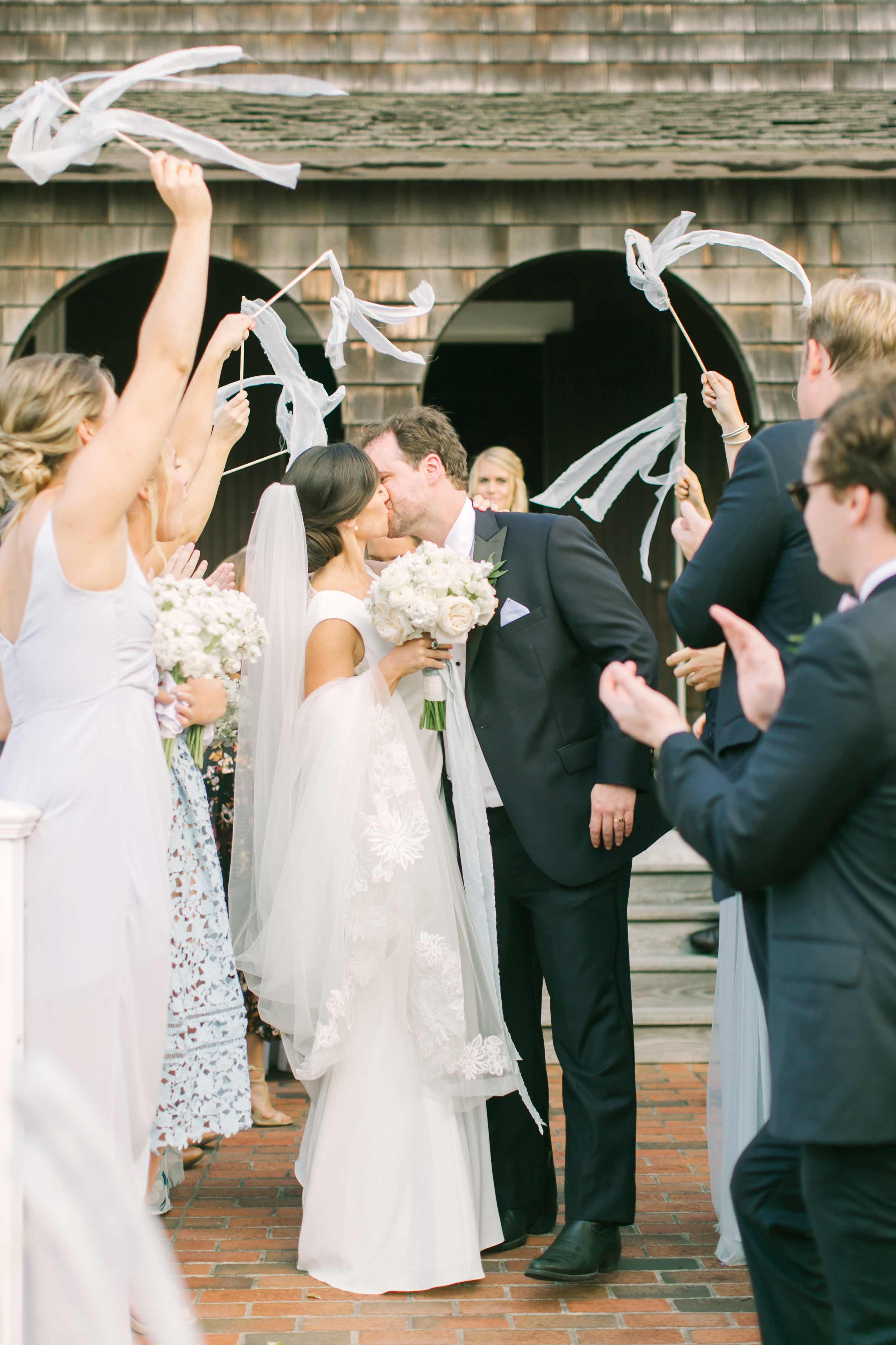 couple wedding exit kiss