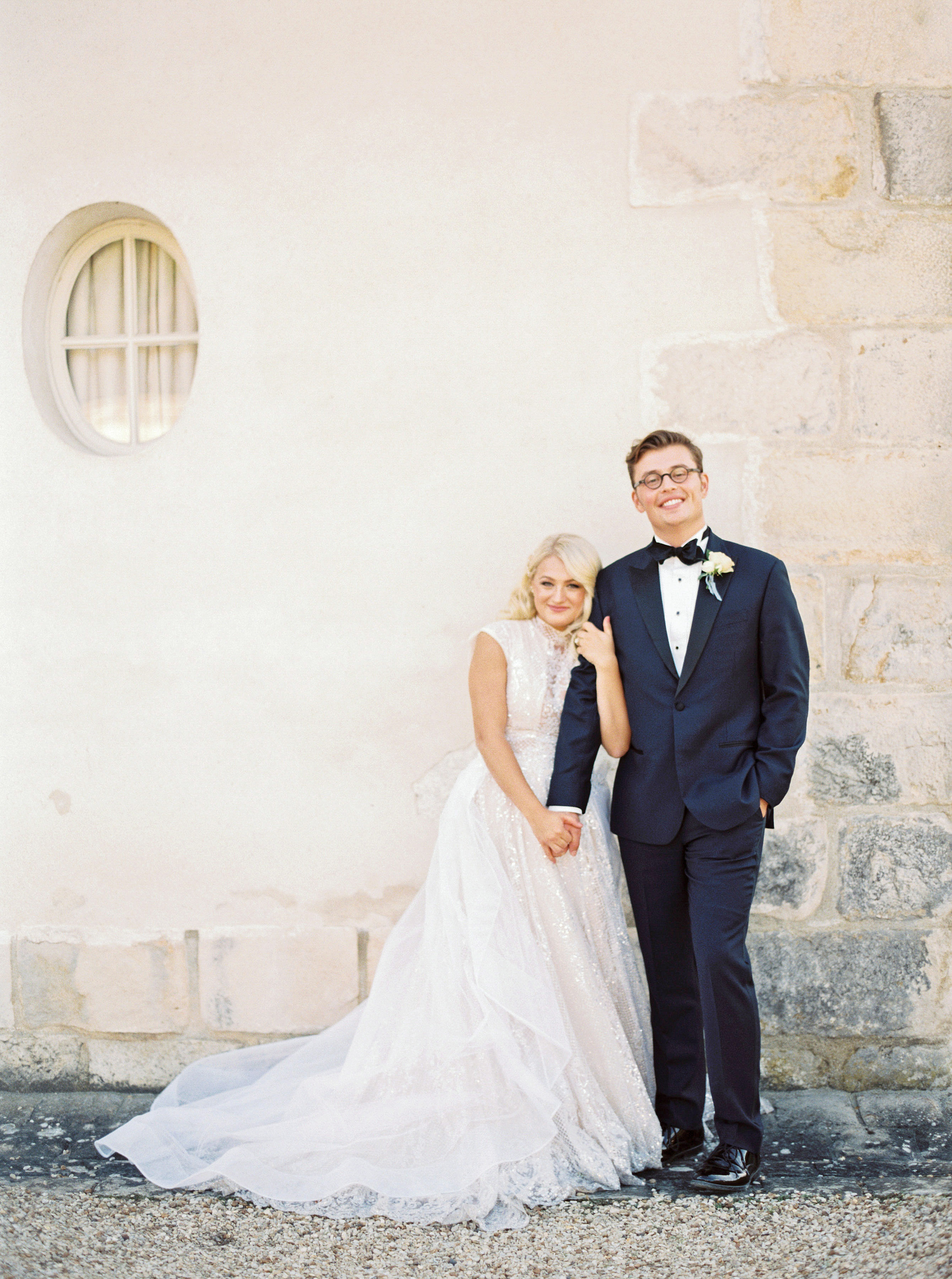 rachael cameron wedding couple in front of wall