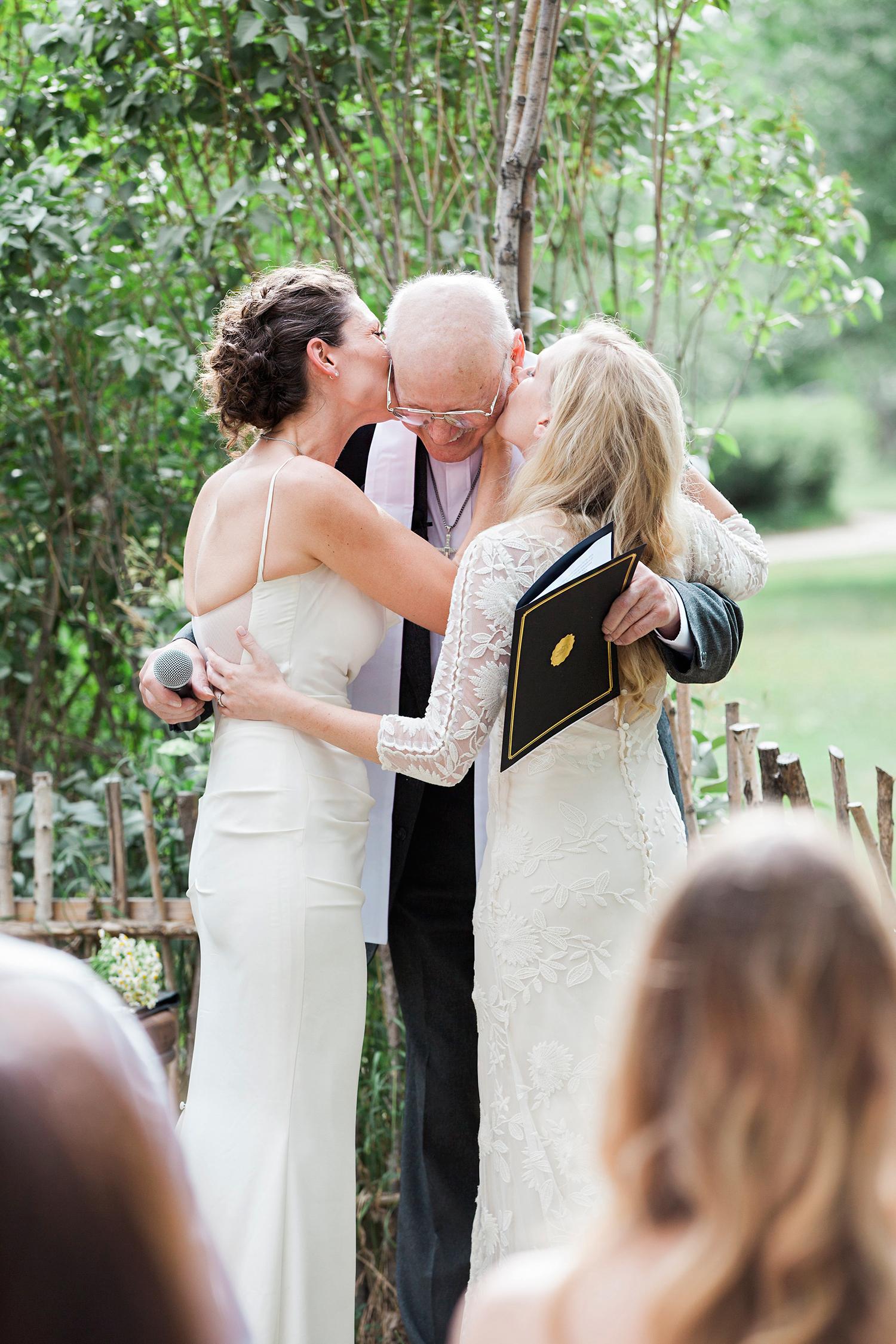 allison aimee wedding kissing officiant on cheeks