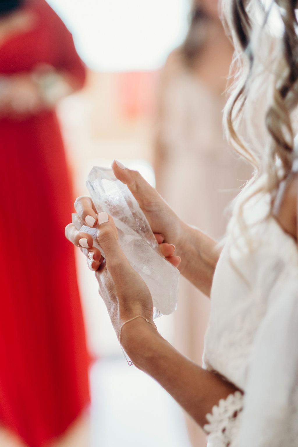 bride holding crystals on wedding day