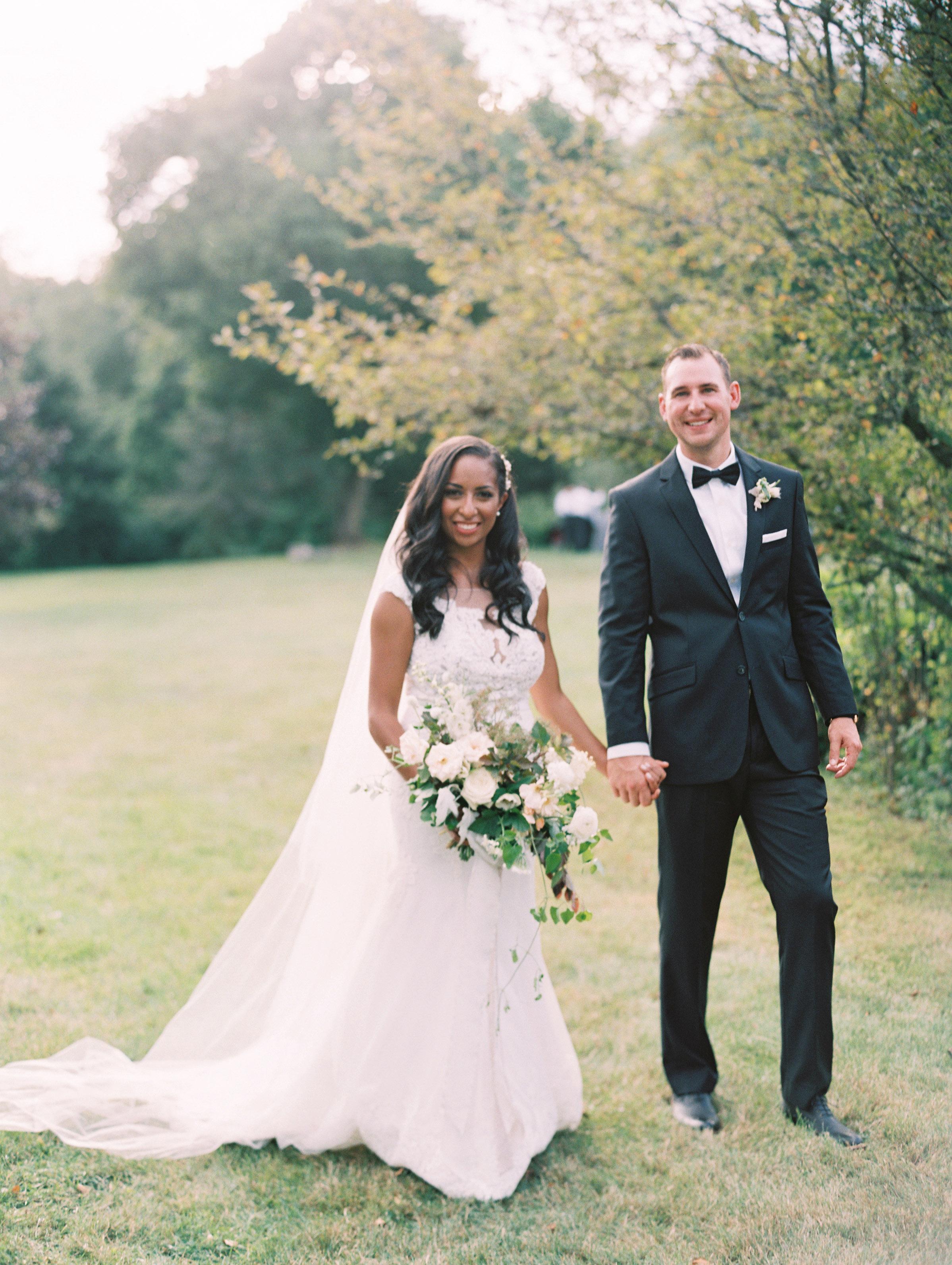 miya matthew wedding couple holding hands