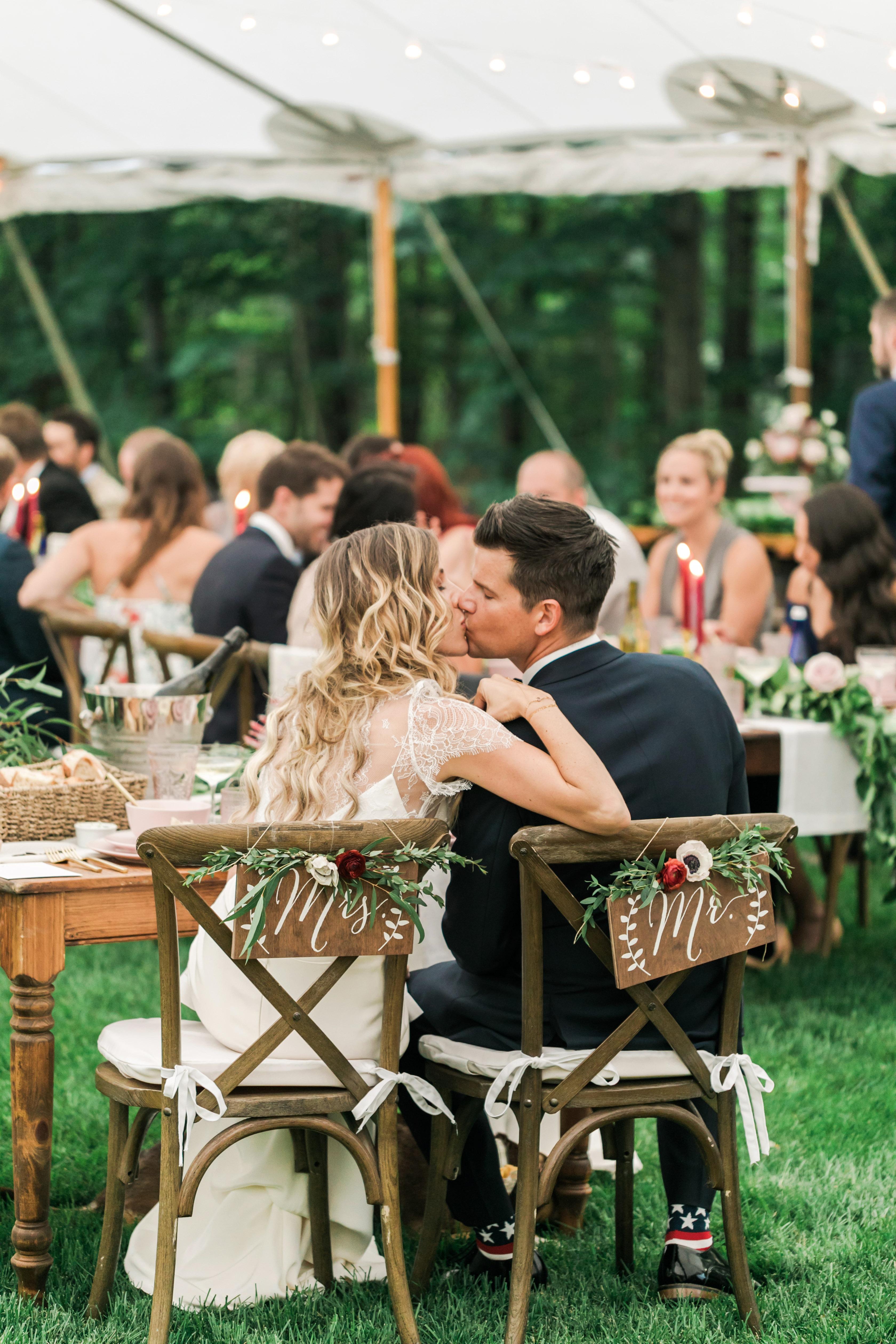 vanessa steven wedding couple kiss chairbacks