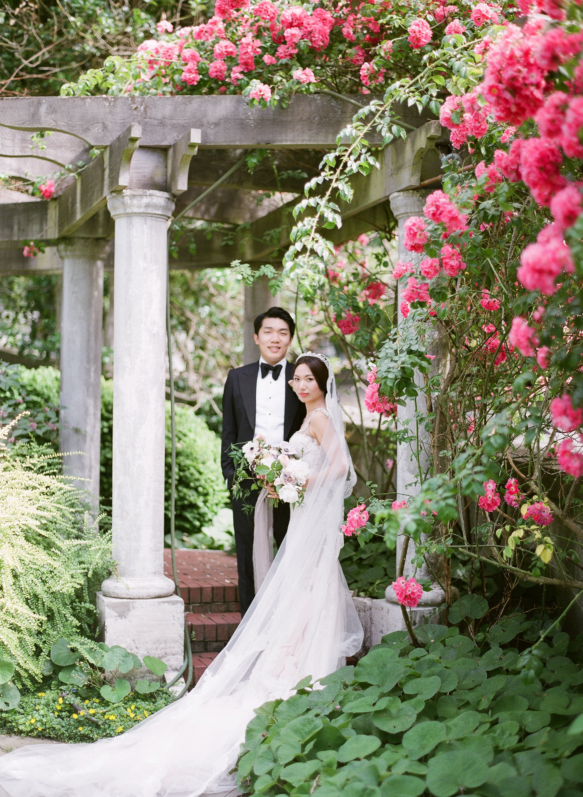 gloria zee wedding couple pergola pink flowers