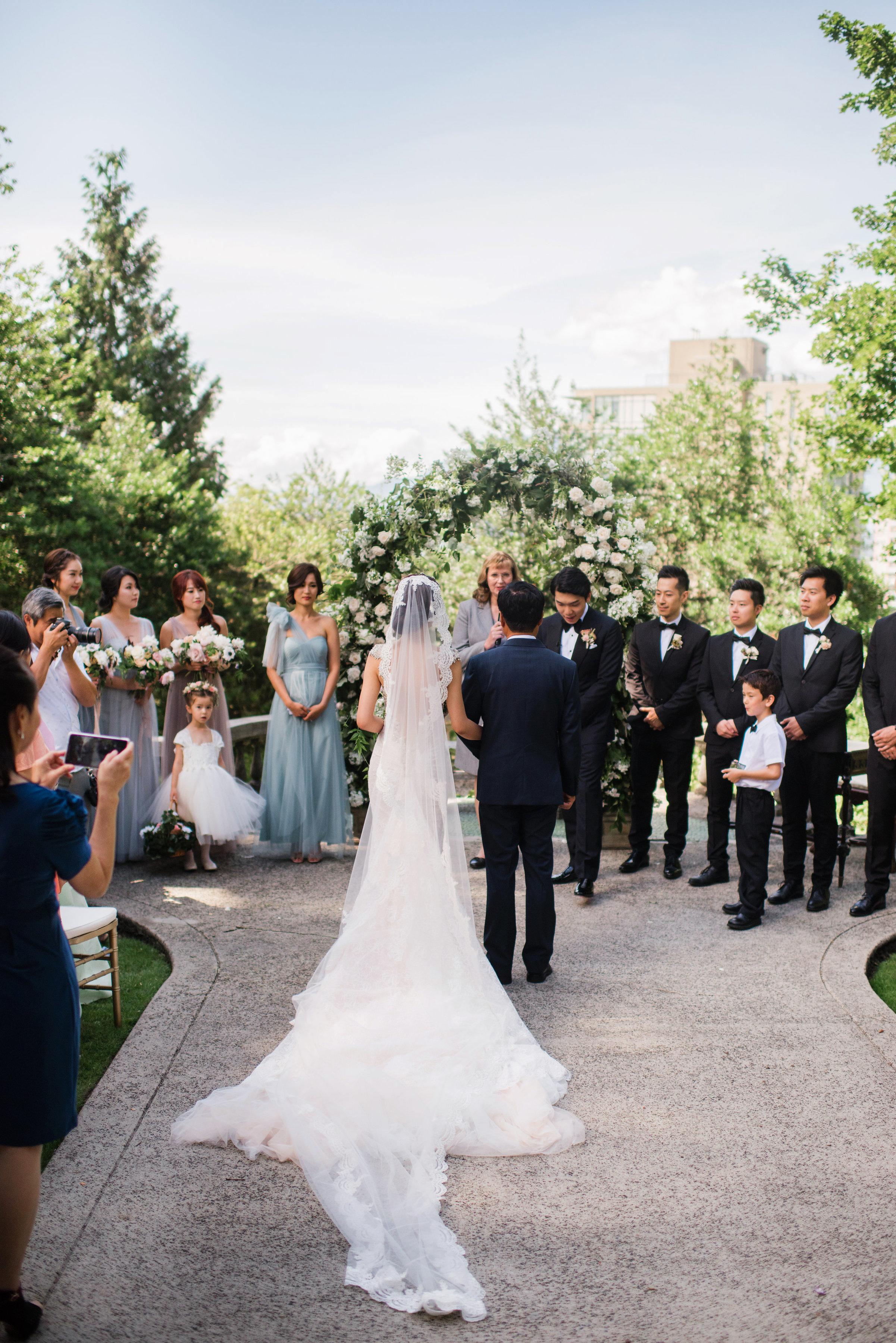 gloria zee wedding ceremony couple at alter