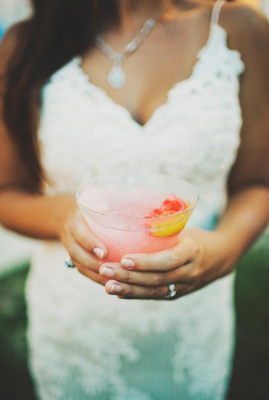bride holding frozen drink