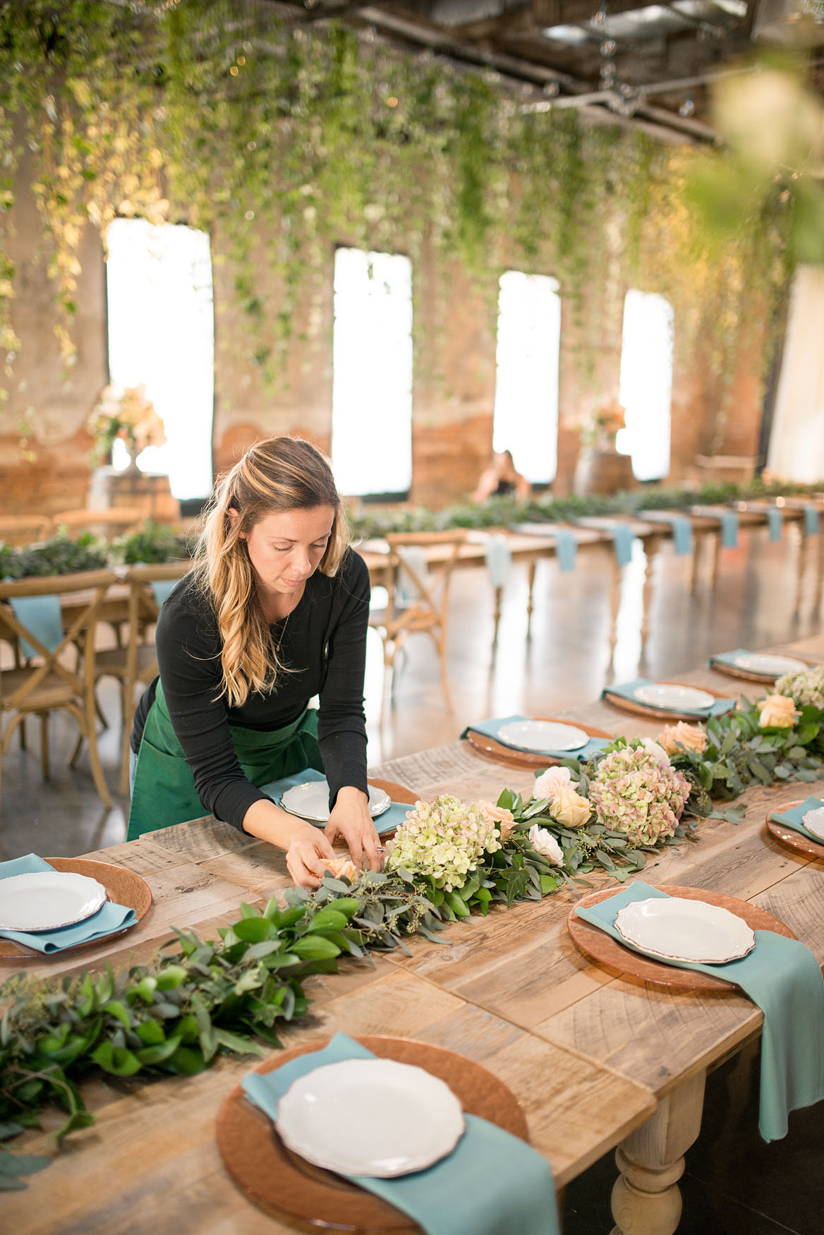 Diana Venditto arranging floral centerpiece