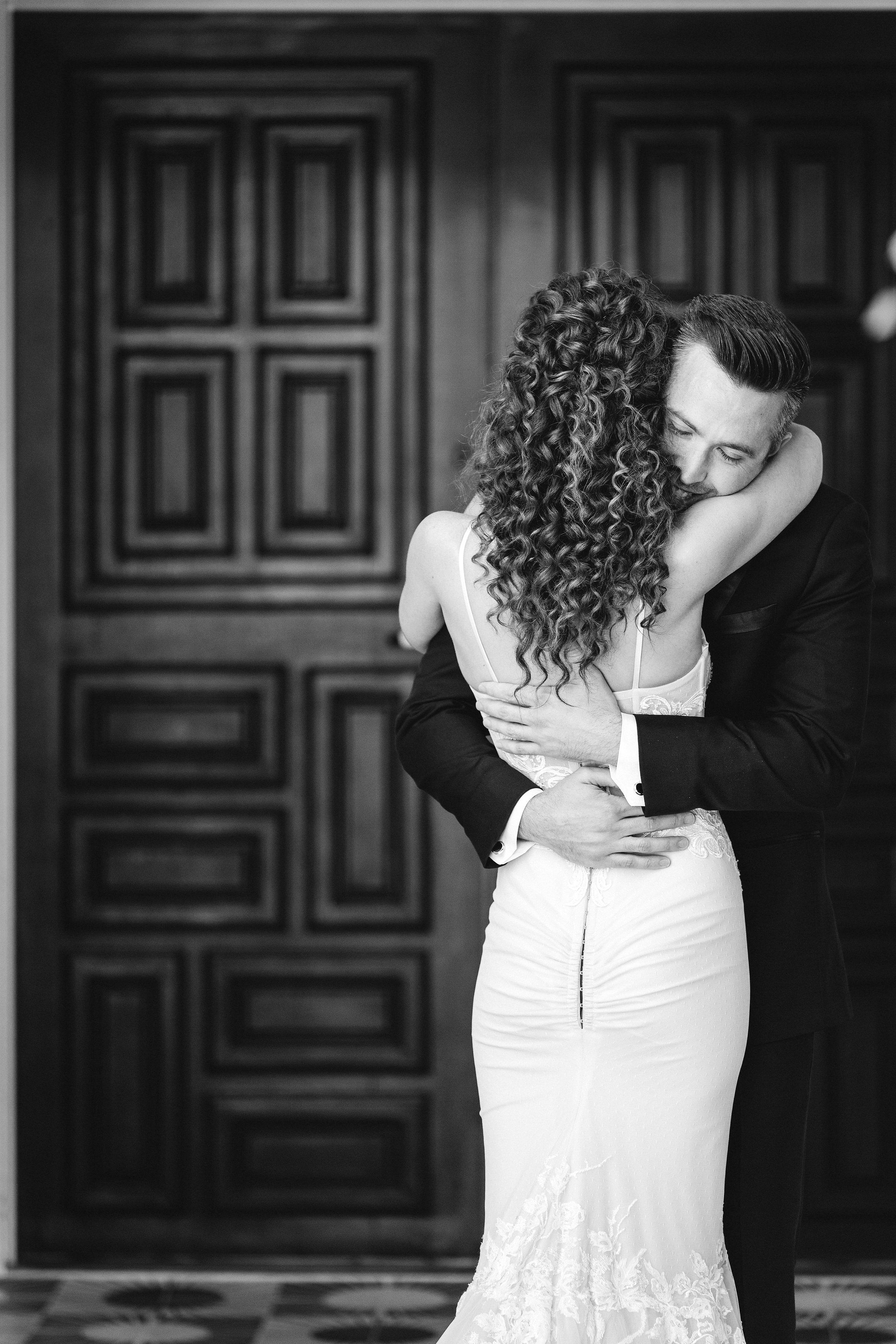 couple first look hug