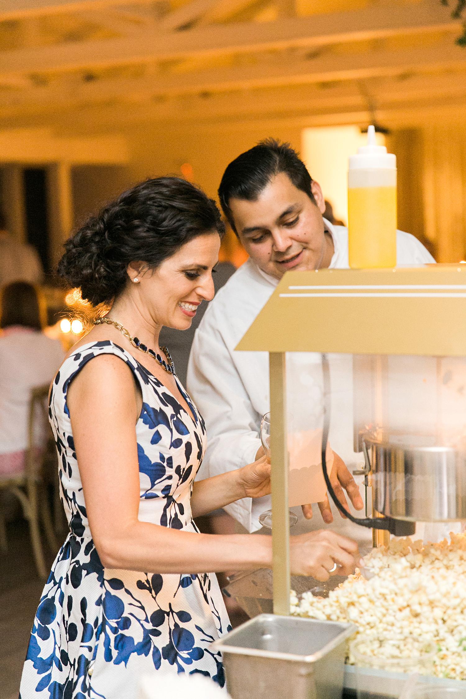 cassandra jason wedding guests with popcorn