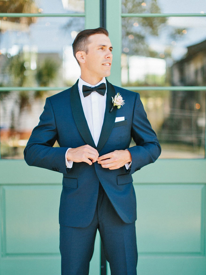 modern wedding groom in navy tux