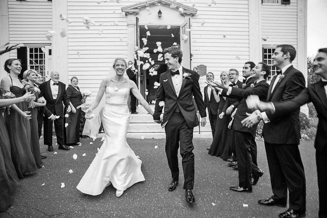 modern wedding guests throwing petals