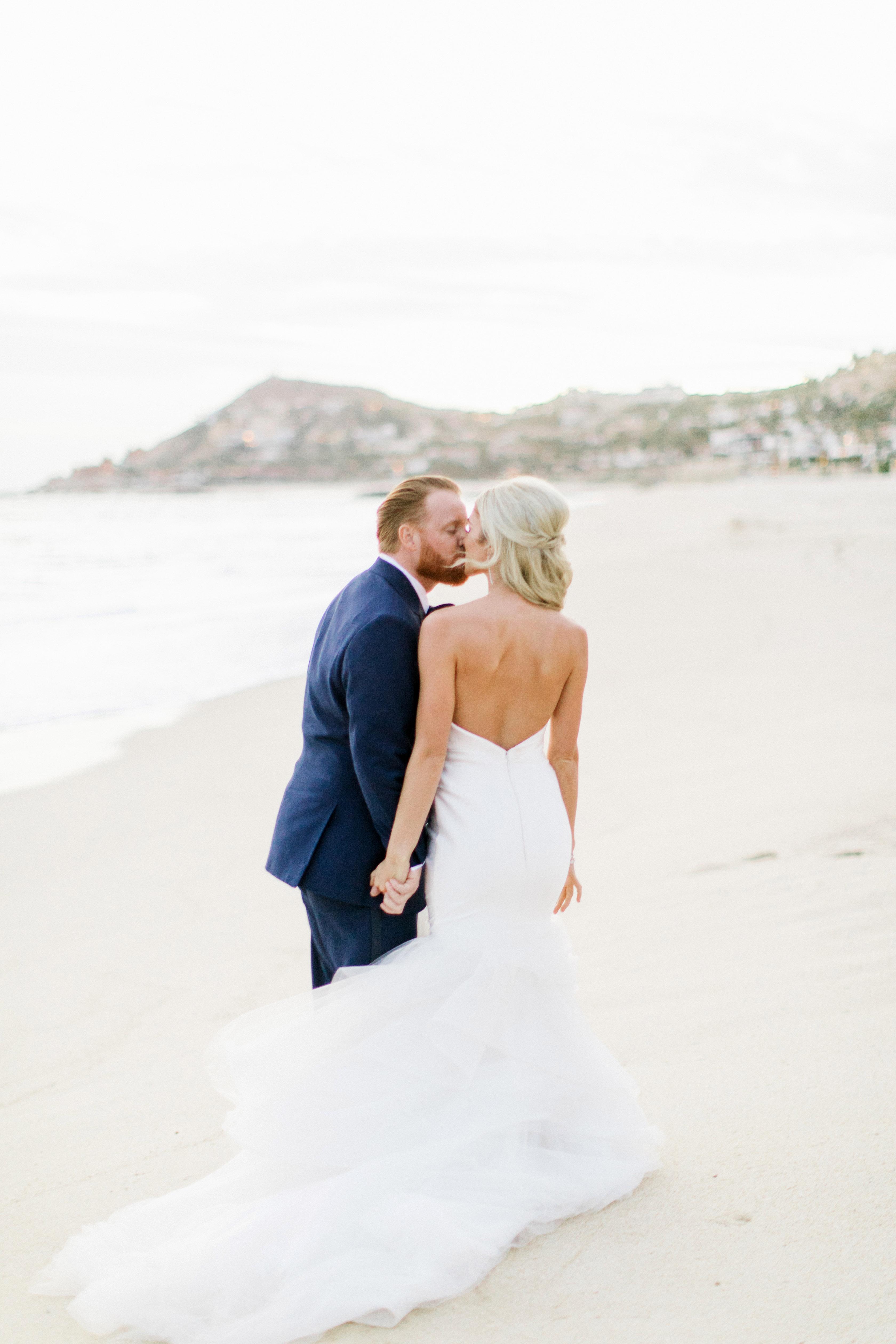 kourtney justin wedding mexico couple kiss beach