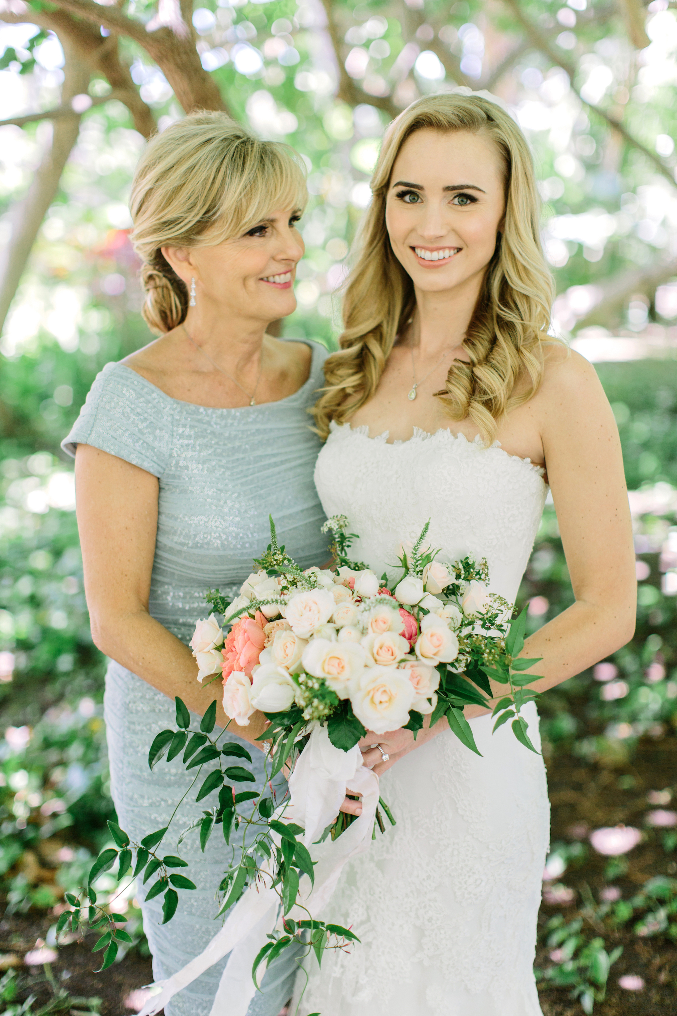 A Bride and Her Mom Holding Her Bouquet