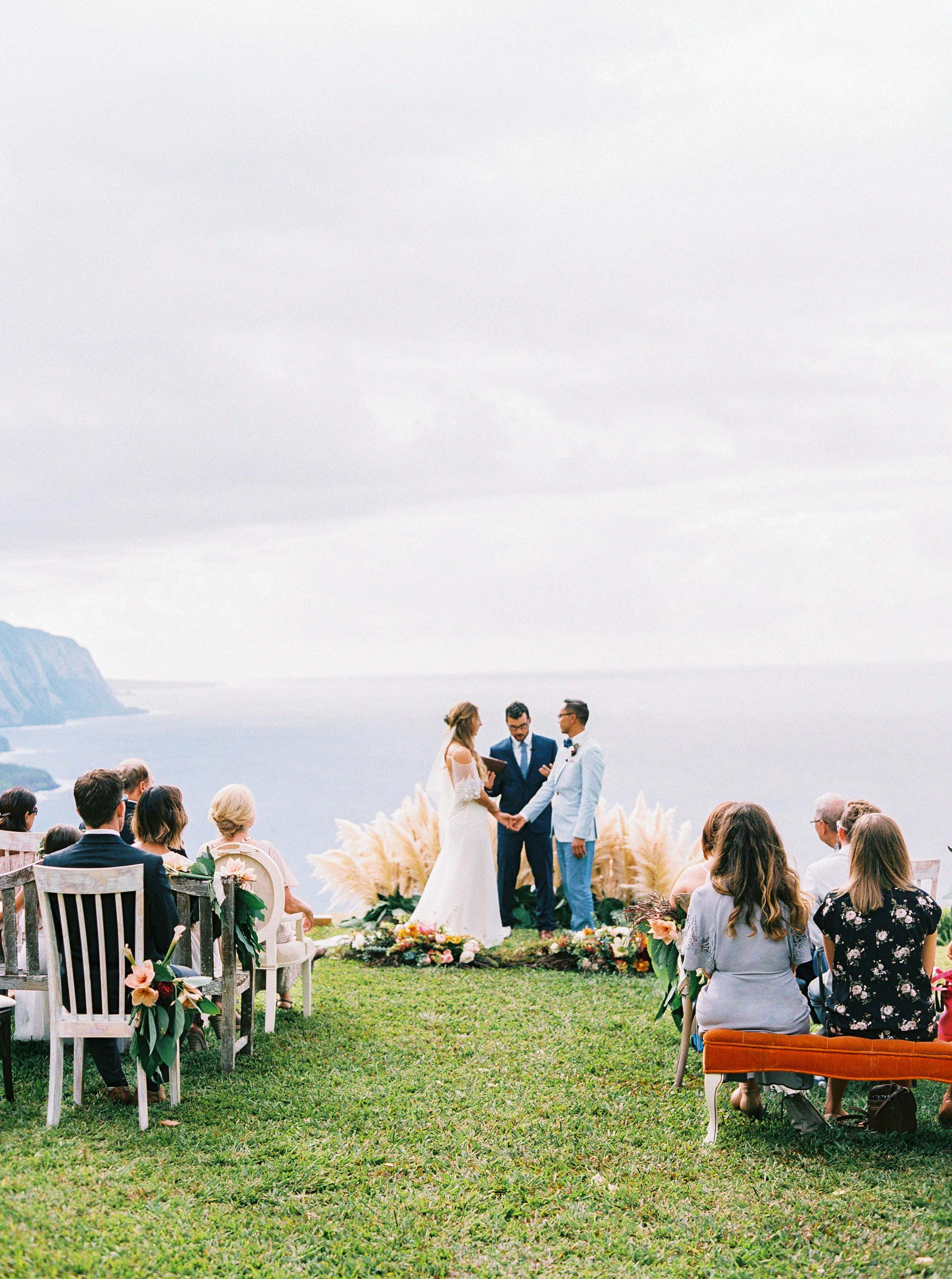rebecca eryck wedding hawaii ceremony cliff edge