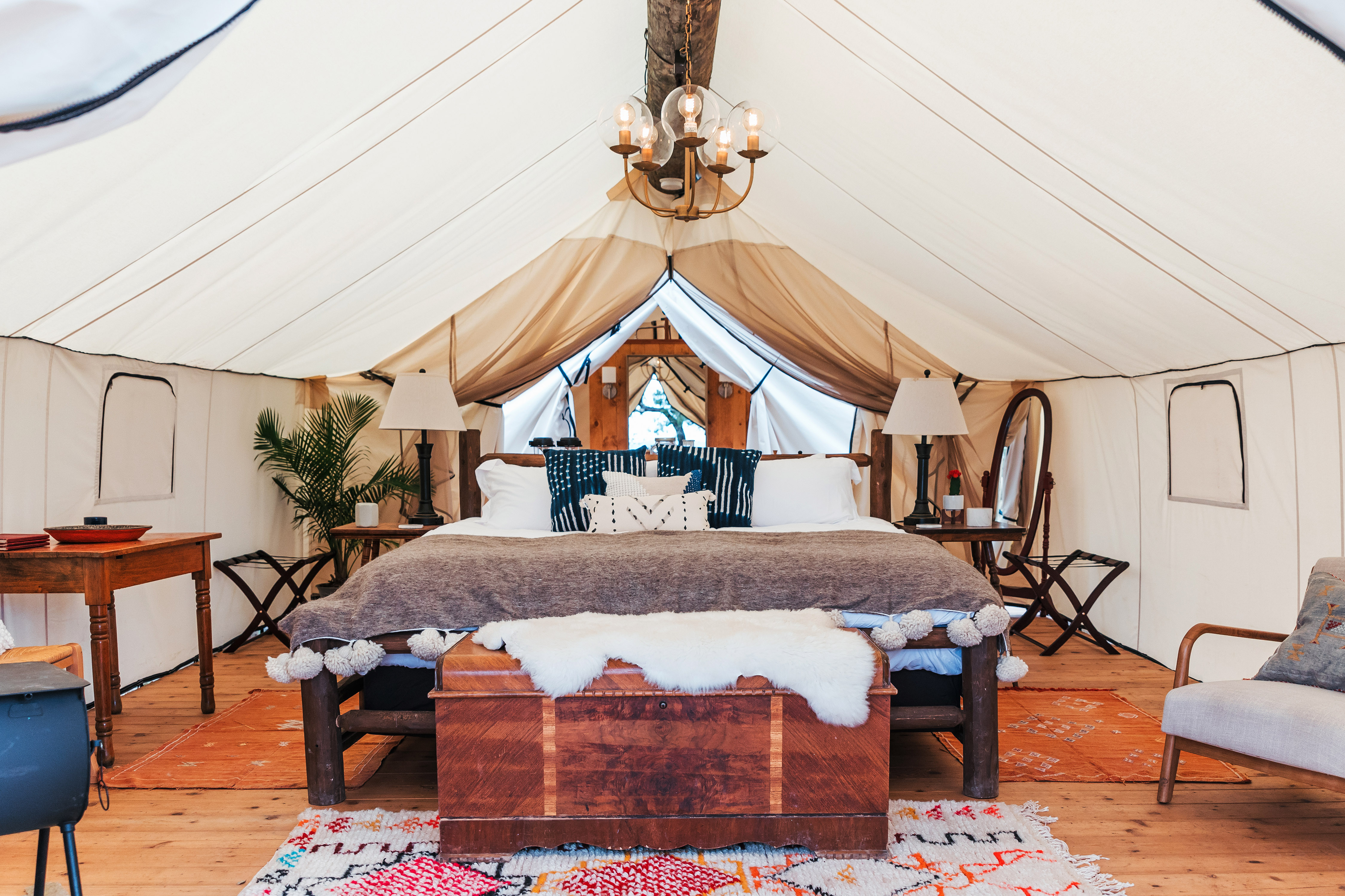 dude ranch honeymoon collective retreats tent bed interior