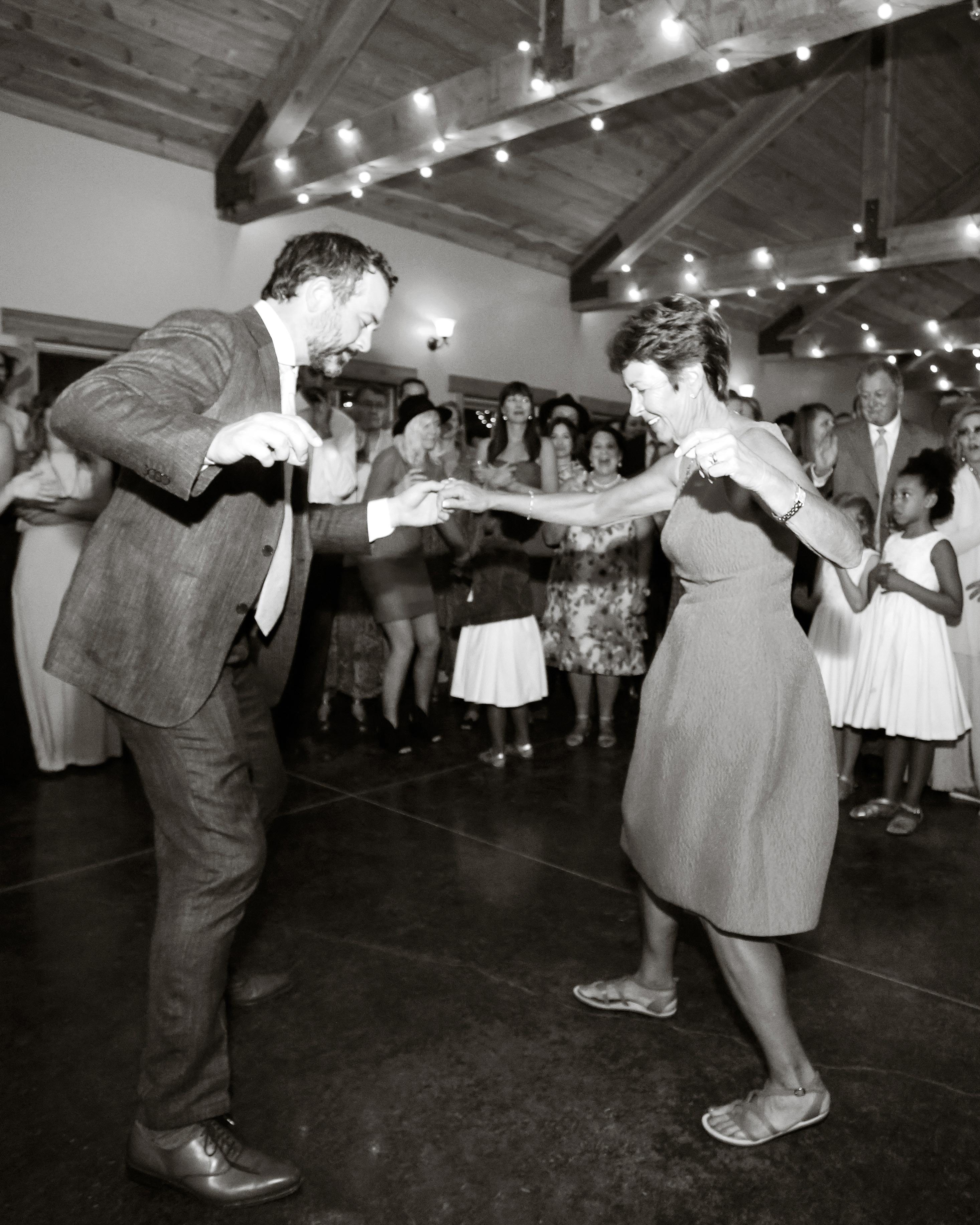 wedding groom mother dancing