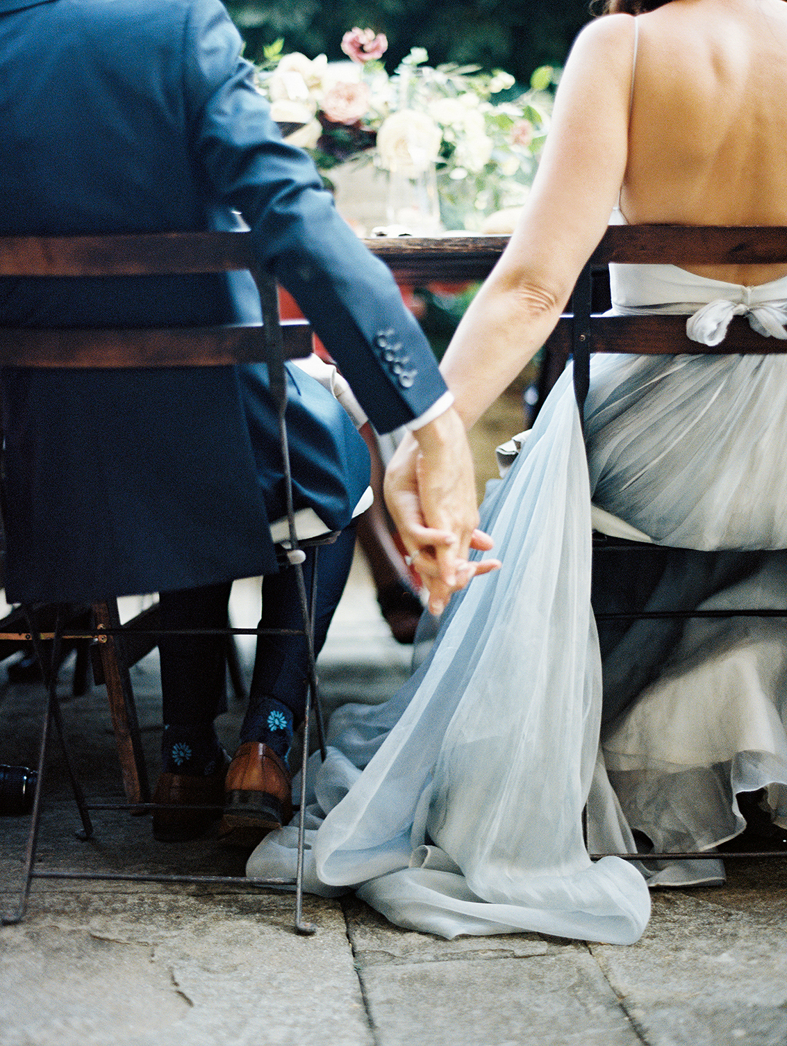 kelly pete wedding couple holding hands detail