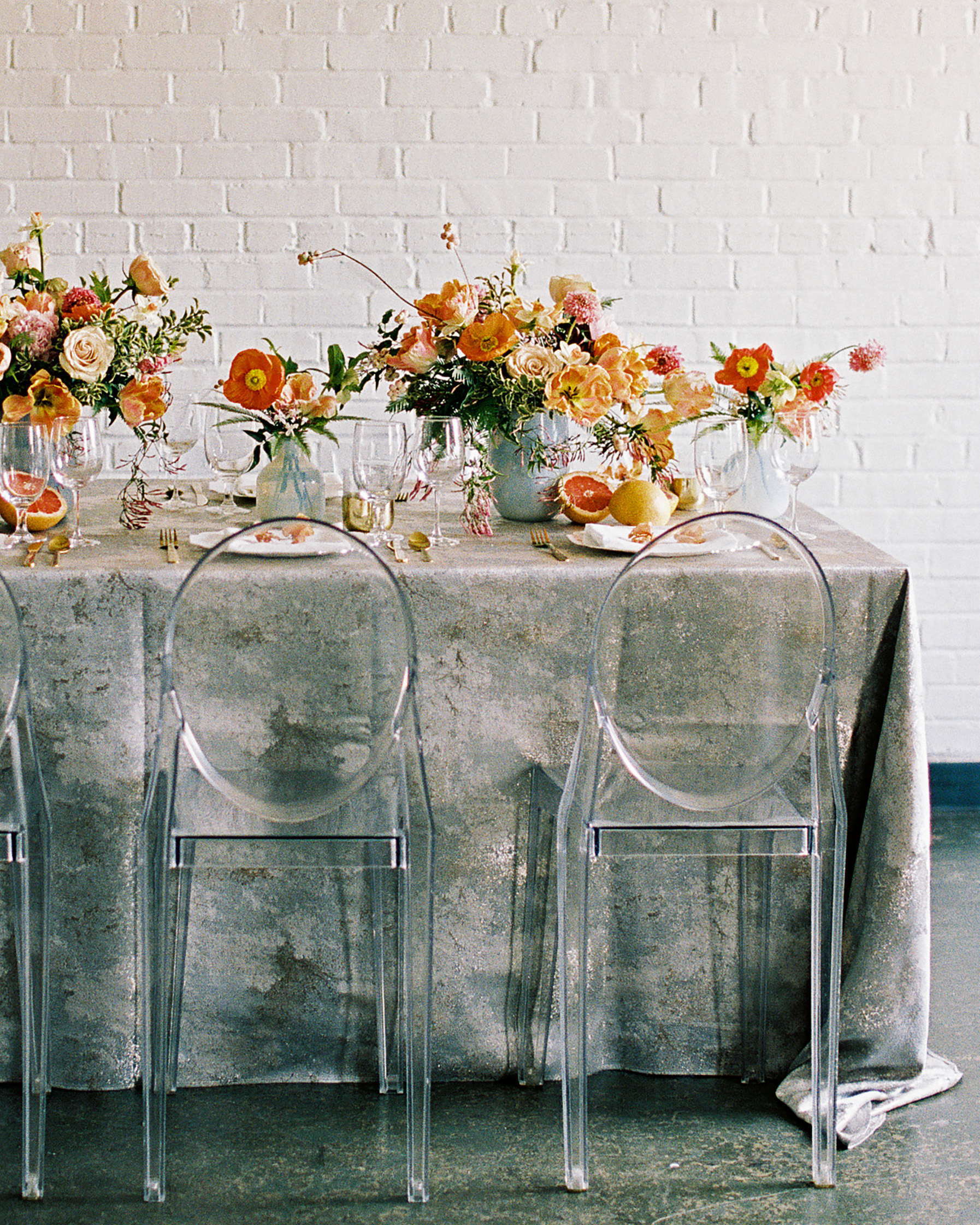 gold speckled tablecloth floral ghost chairs
