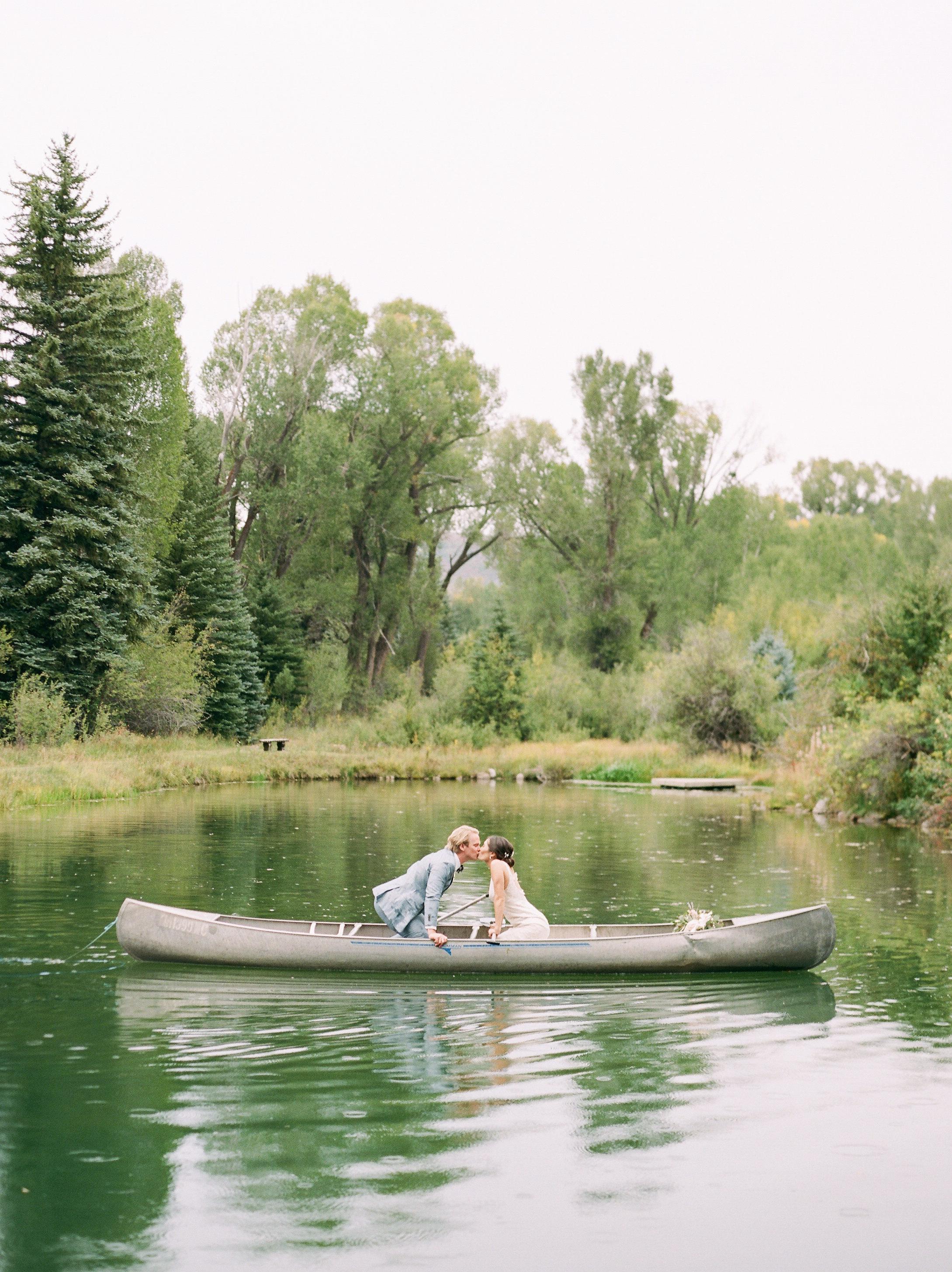 margaux patrick wedding couple canoe kiss