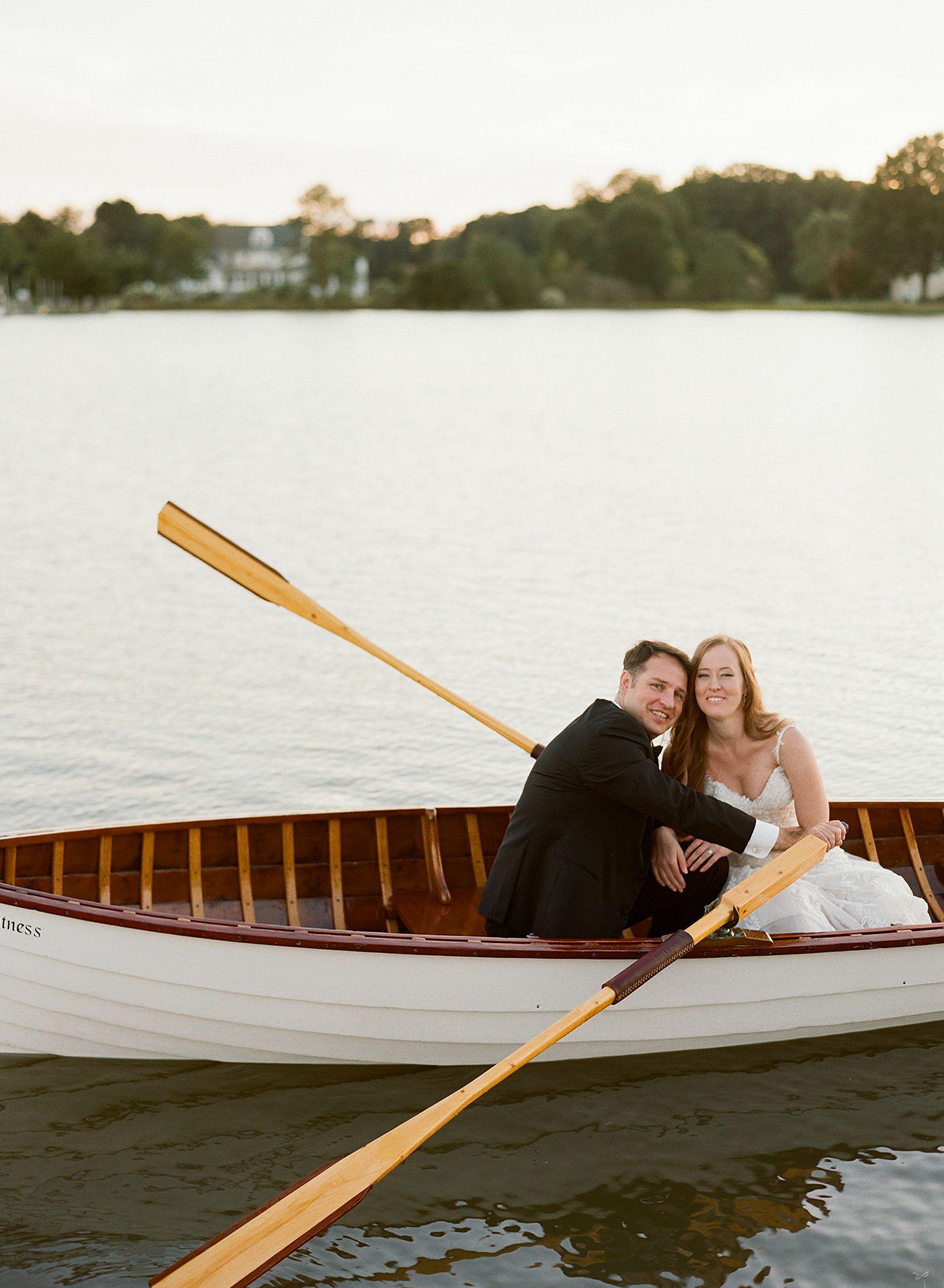 jen geoff wedding couple paddling in canoe
