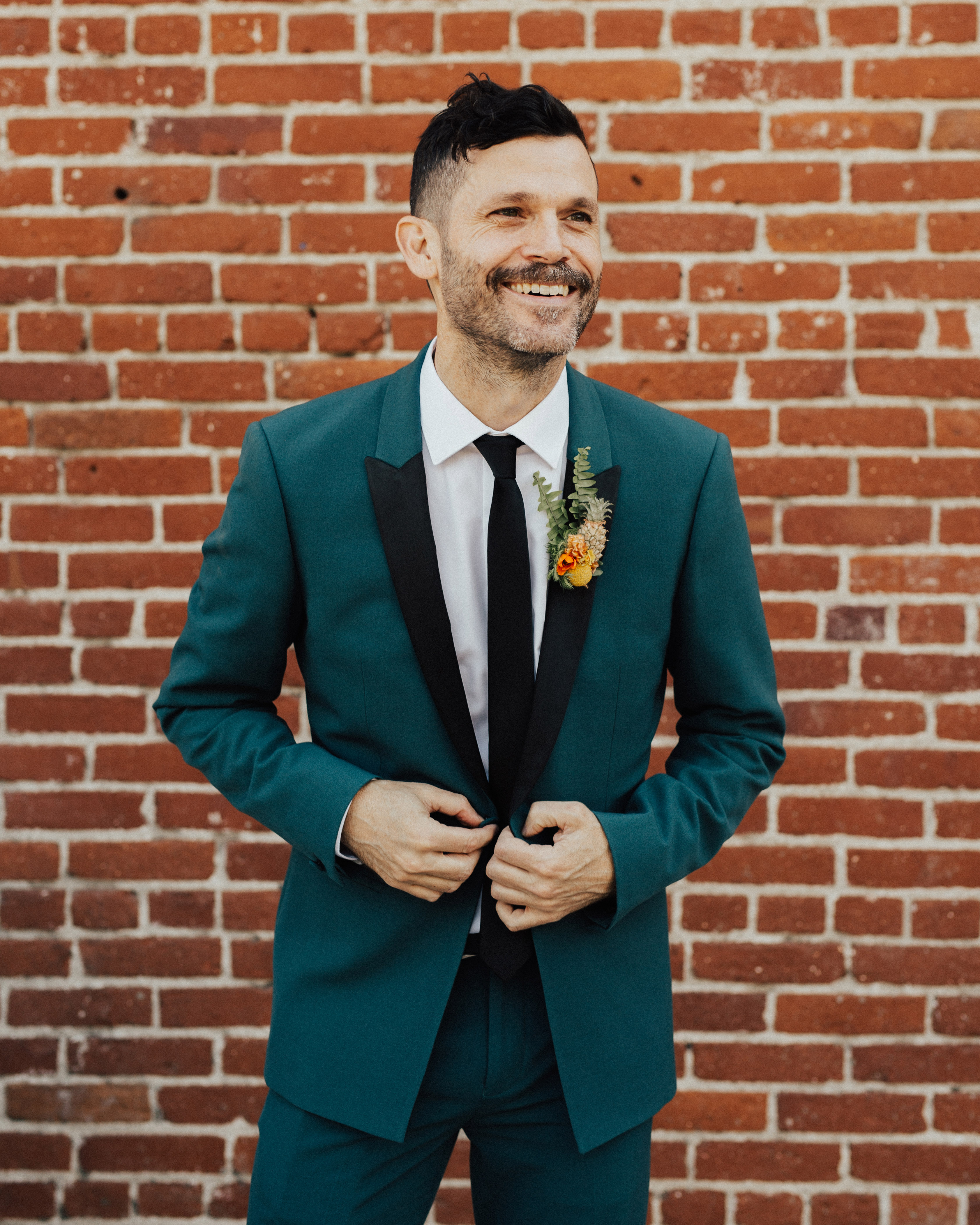green Topman suit with black accents